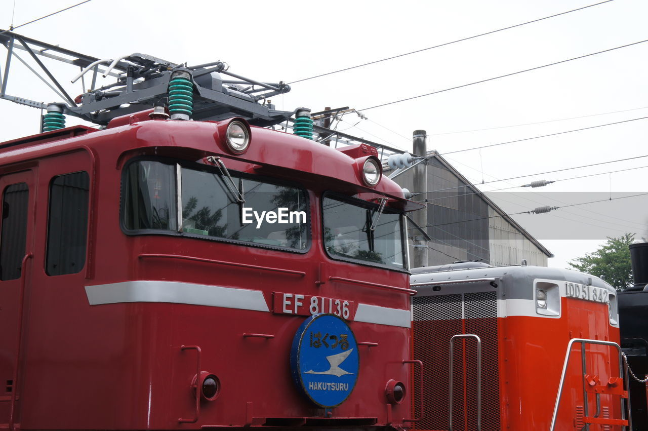 red, cable, day, transportation, power supply, mode of transport, outdoors, no people, sky, overhead cable car, nautical vessel, close-up