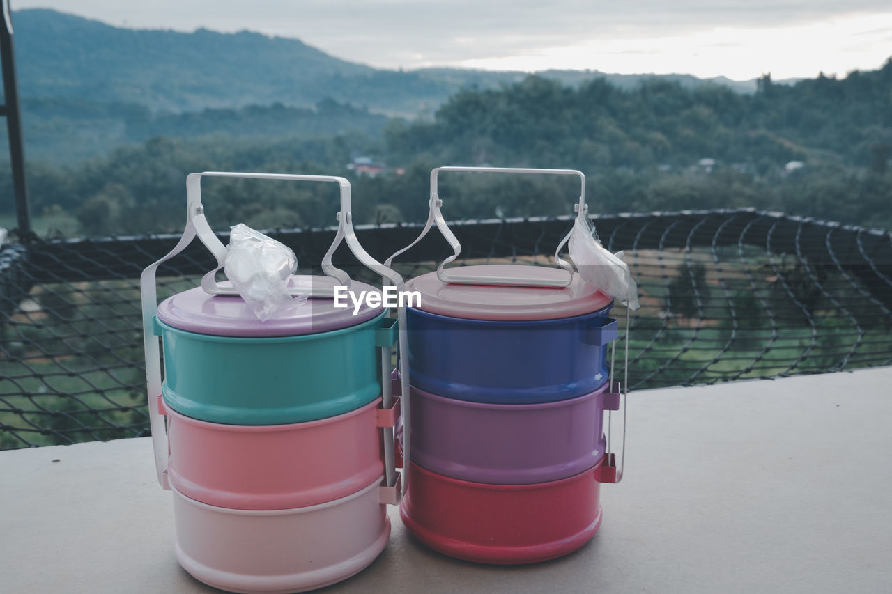CLOSE-UP OF PINK WATER IN CONTAINER ON TABLE