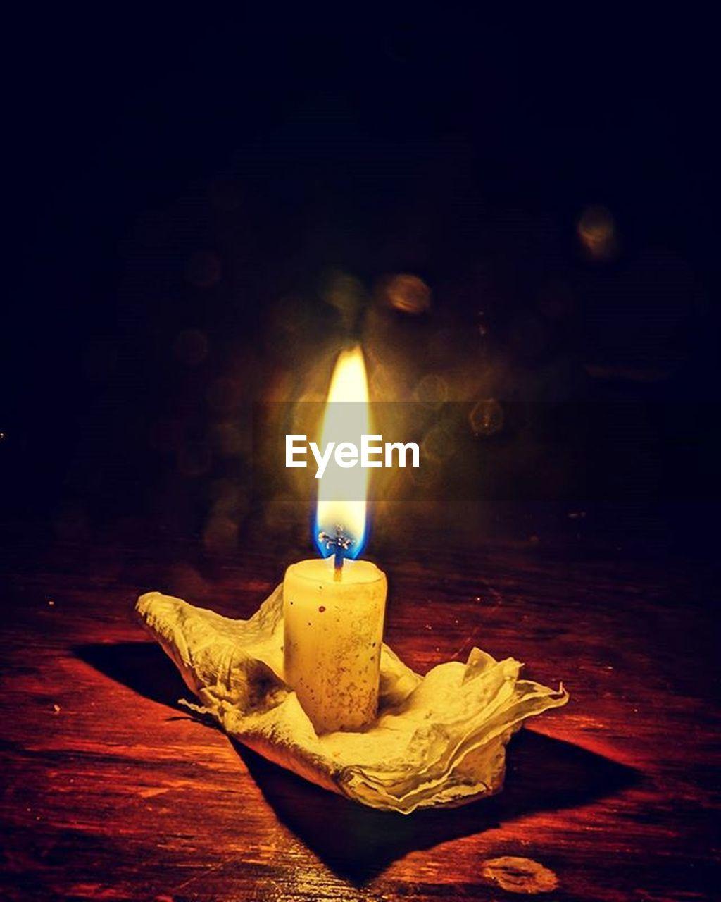 flame, burning, candle, heat - temperature, glowing, no people, close-up, illuminated, night, oil lamp, indoors, diya - oil lamp