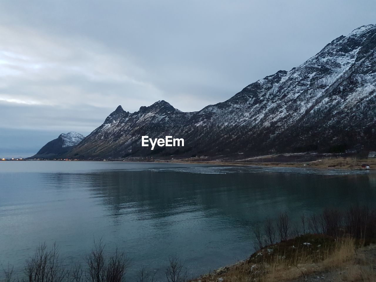 water, mountain, sky, beauty in nature, lake, scenics - nature, tranquil scene, tranquility, cold temperature, nature, no people, idyllic, waterfront, day, cloud - sky, reflection, non-urban scene, mountain range, environment, outdoors
