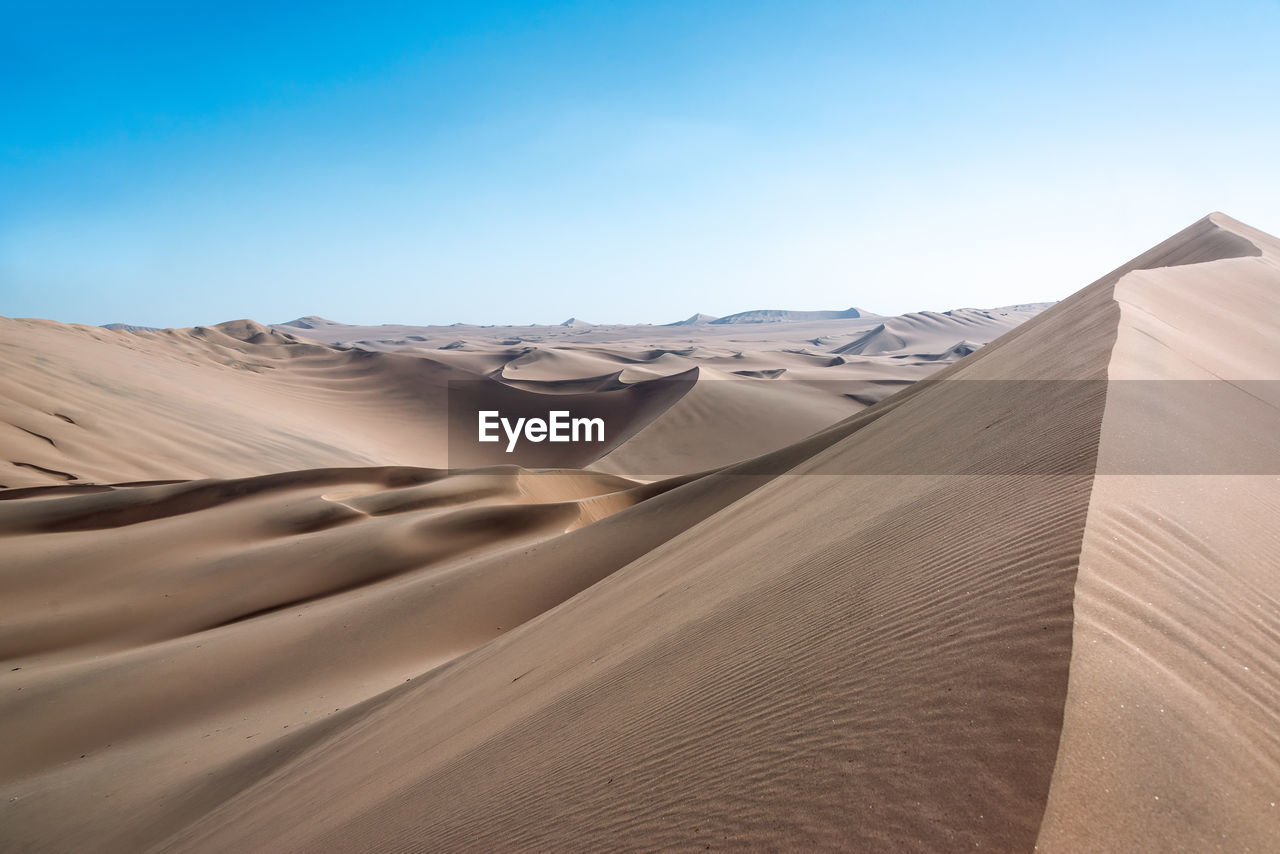 Scenic View Of Desert Against Sky At Huacachina