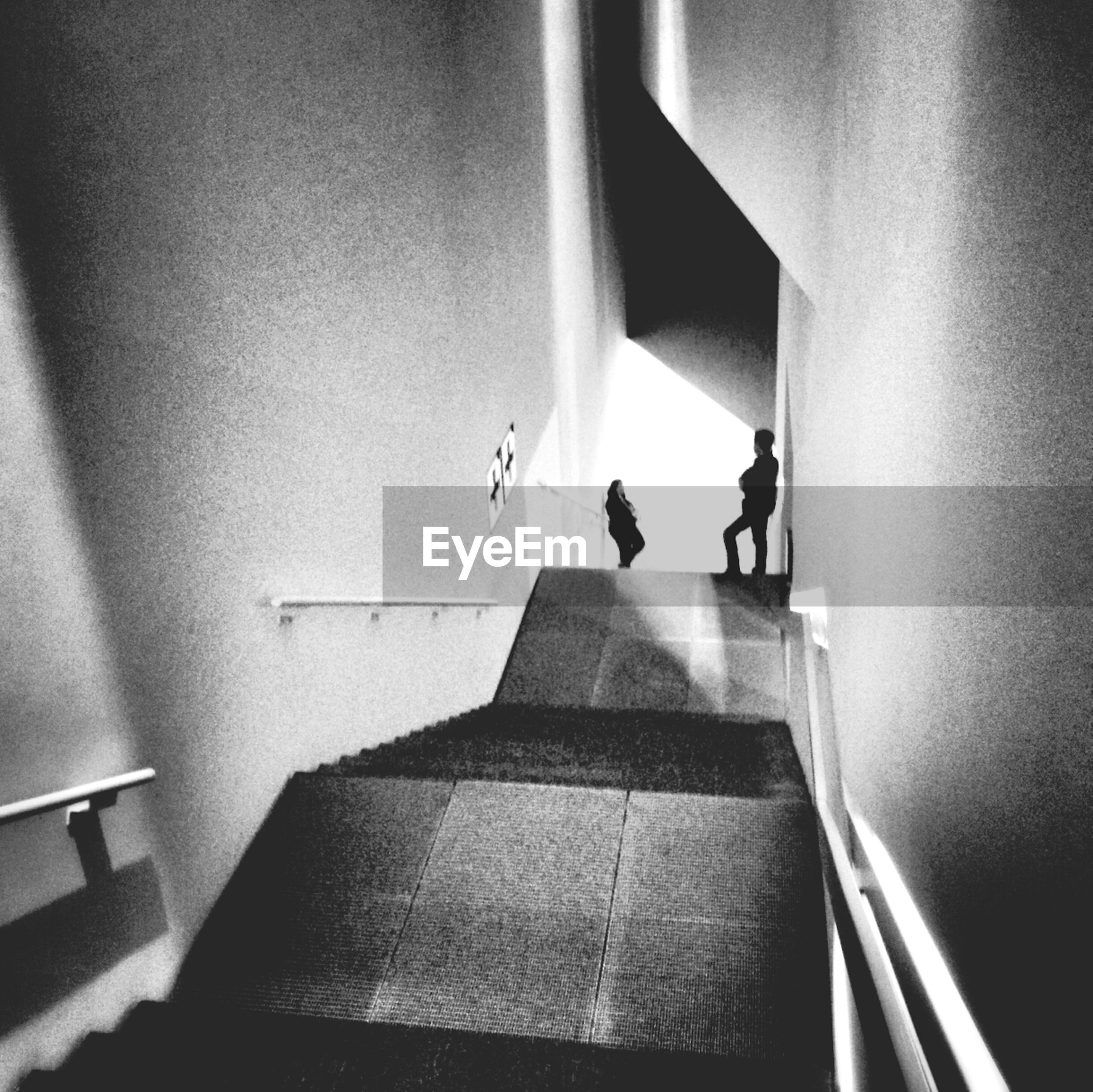indoors, men, lifestyles, steps, staircase, steps and staircases, person, walking, full length, illuminated, wall - building feature, built structure, leisure activity, architecture, railing, corridor, rear view, flooring