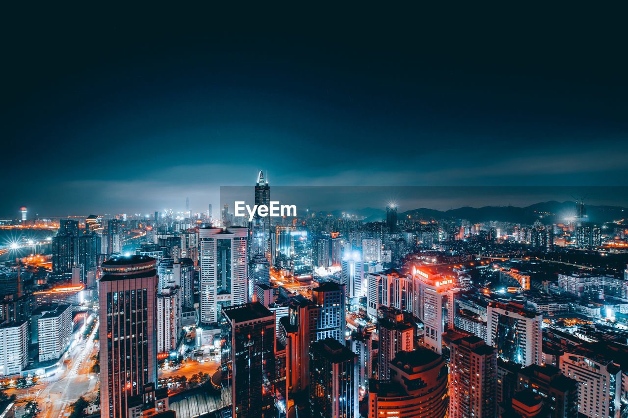 building exterior, built structure, architecture, cityscape, city, building, illuminated, sky, tall - high, office building exterior, skyscraper, high angle view, modern, night, crowd, nature, urban skyline, tower, crowded, outdoors, financial district, spire