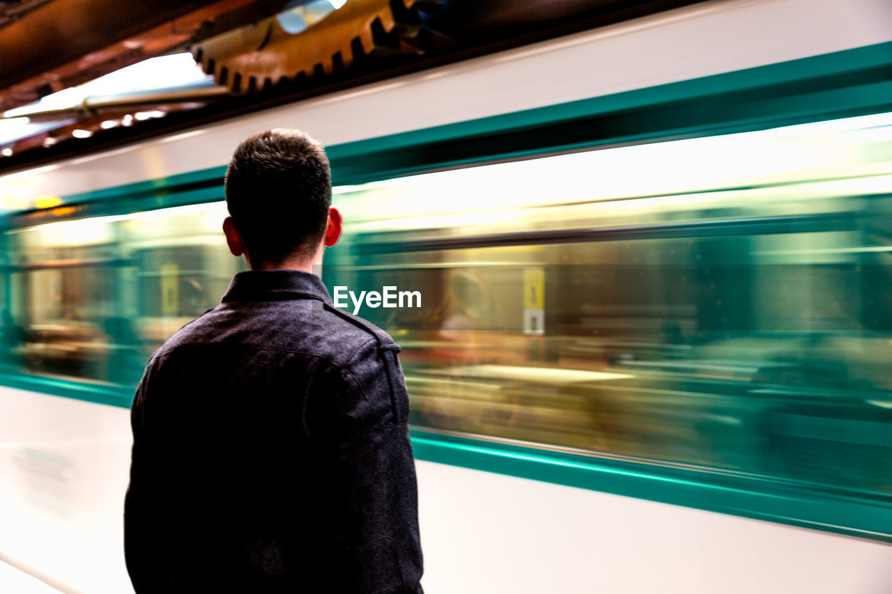 Rear View Of Man In Underground Station