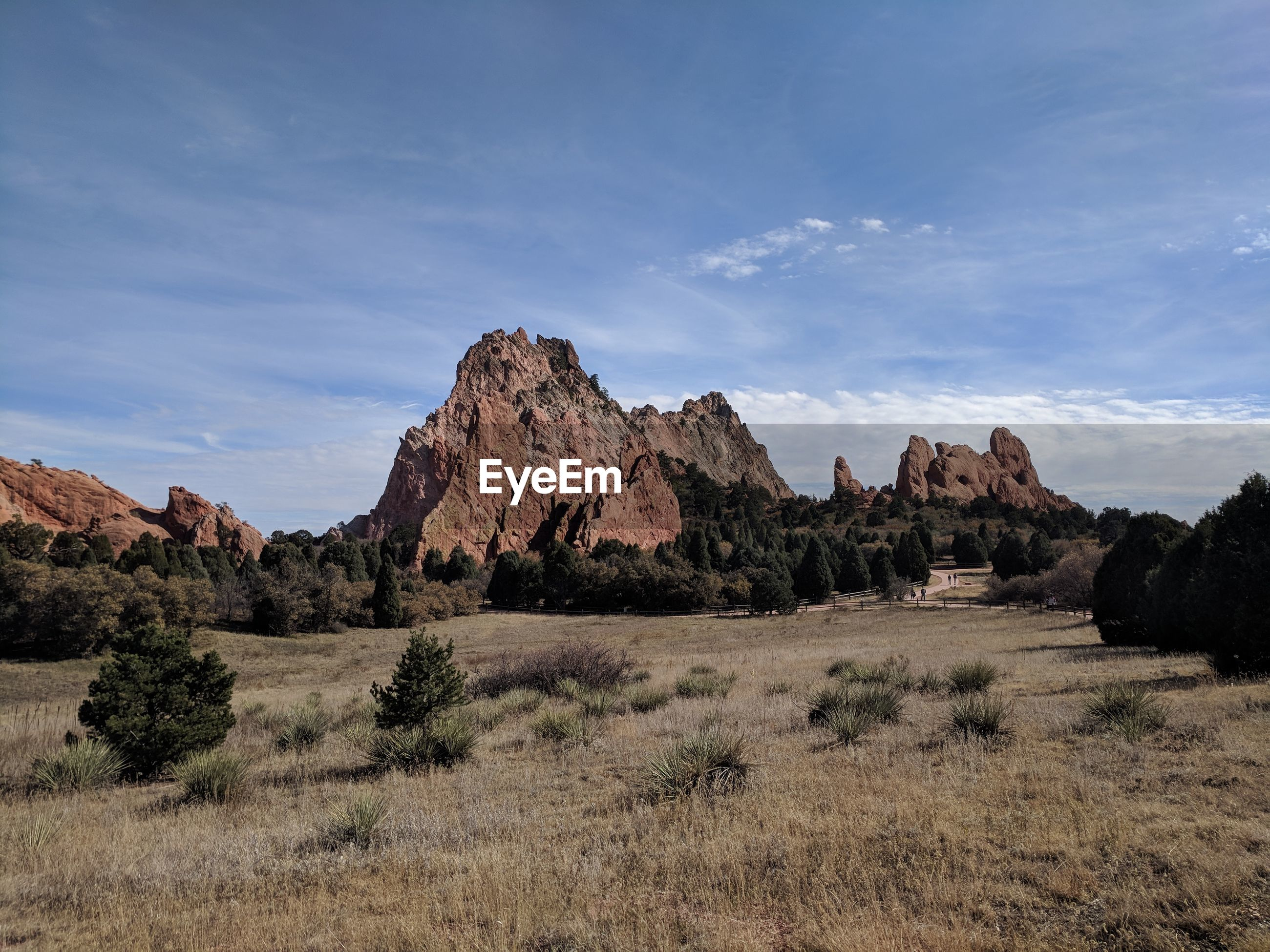 PANORAMIC VIEW OF ROCKS ON LAND AGAINST SKY