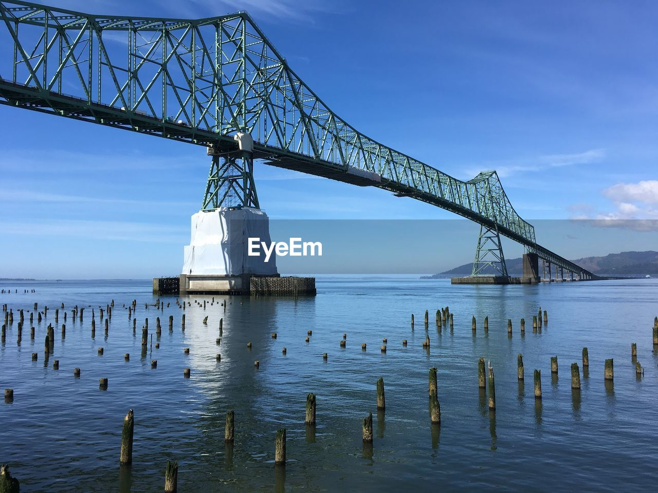 bridge - man made structure, connection, transportation, sky, built structure, water, travel destinations, outdoors, architecture, sea, day, travel, tranquility, cloud - sky, no people, nature, scenics, beauty in nature