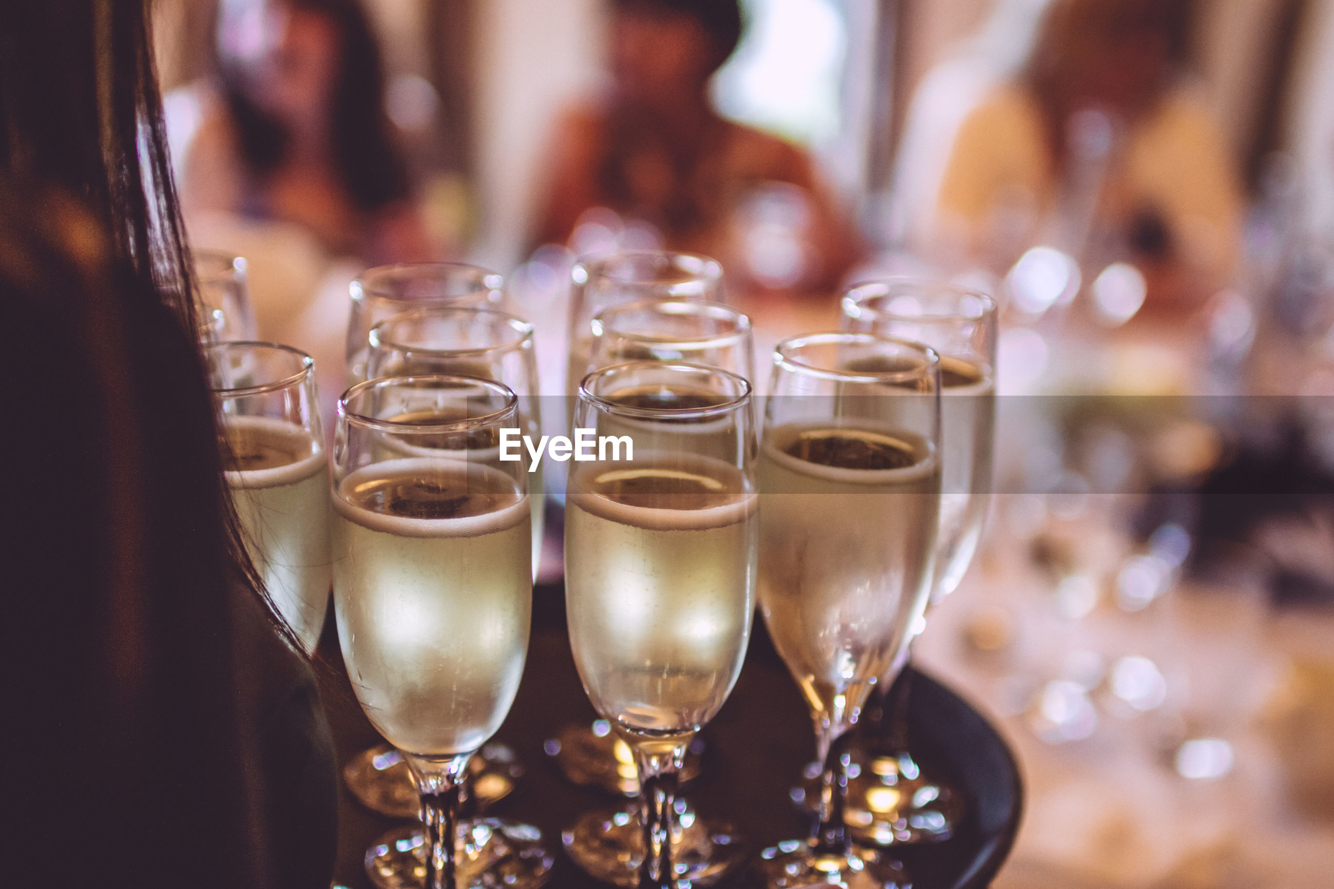 Close-up of champagne glasses on tray at restaurant