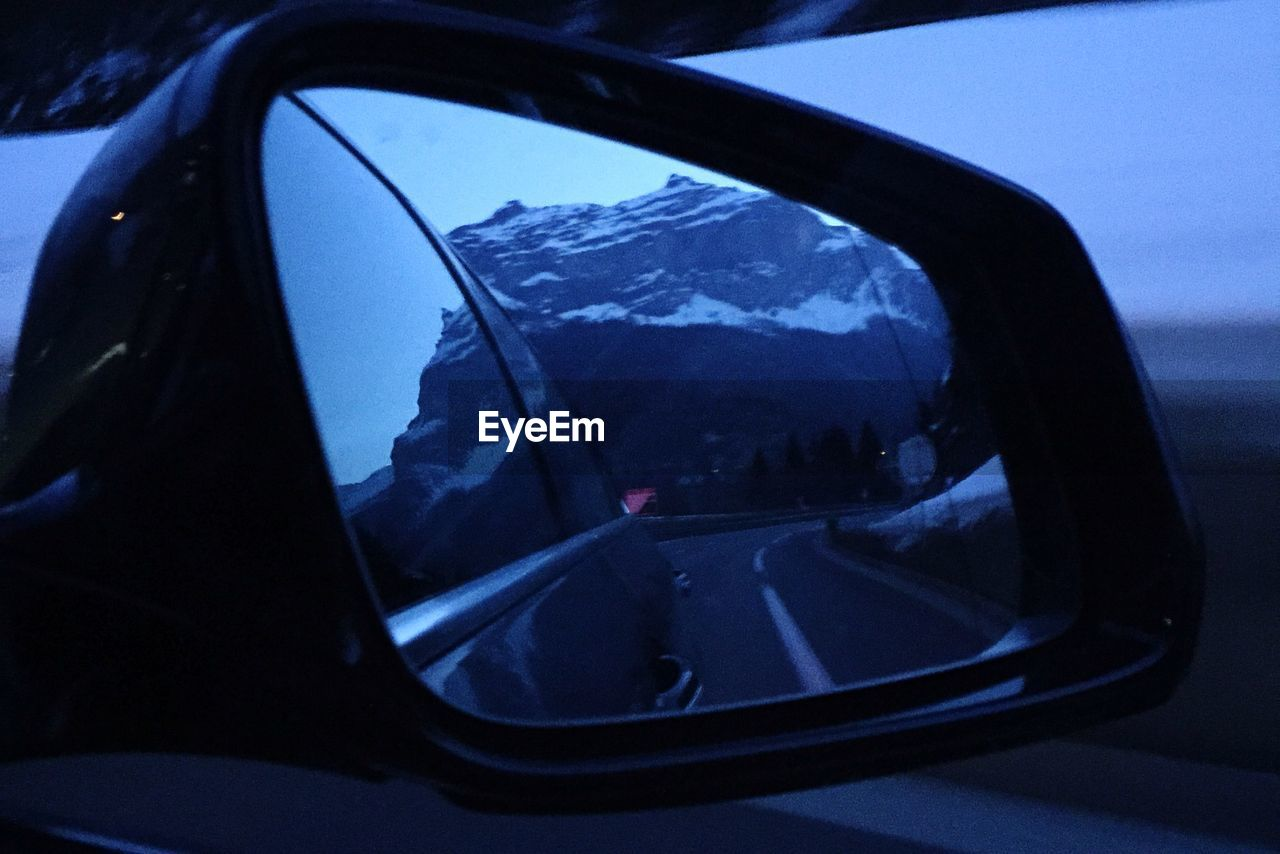 side-view mirror, car, no people, close-up, transportation, outdoors, day, sky