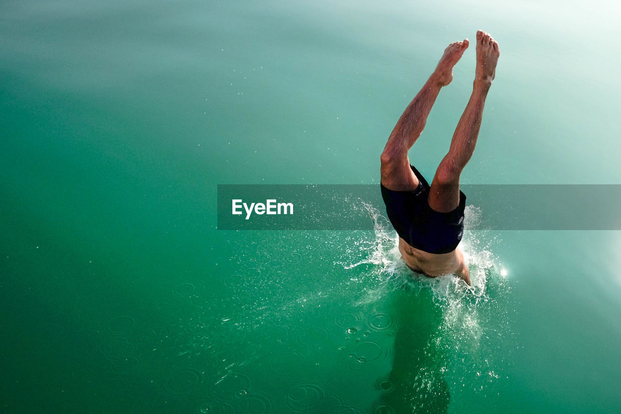 High angle view of man diving in lake