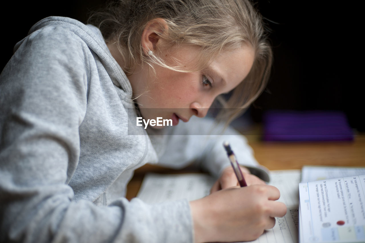 Close-up of girl studying
