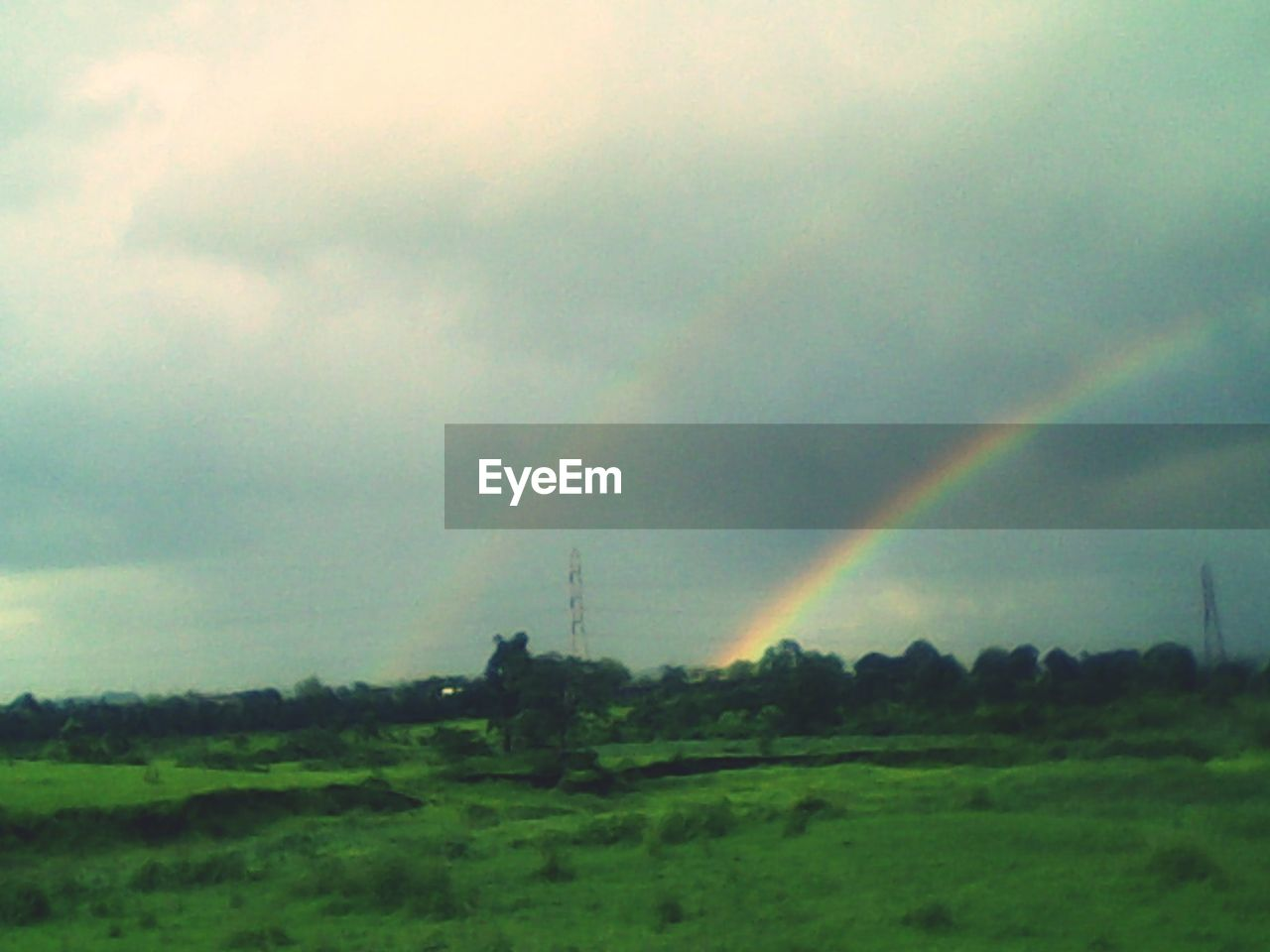 cloud - sky, beauty in nature, sky, scenics - nature, rainbow, landscape, environment, tranquil scene, tranquility, plant, field, no people, nature, non-urban scene, idyllic, land, tree, day, green color, outdoors, double rainbow, rain