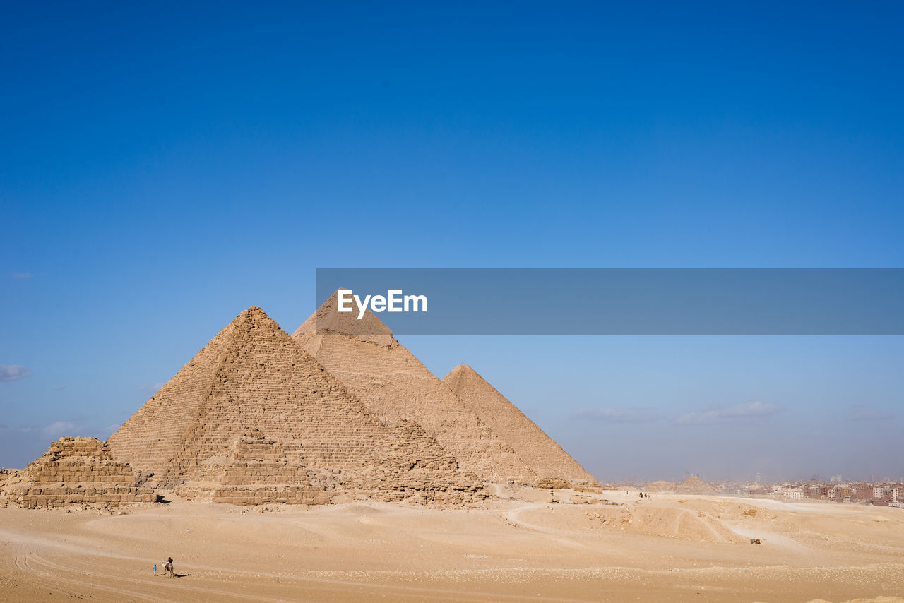 desert, pyramid, sky, land, the past, history, ancient civilization, ancient, blue, landscape, climate, sand, travel, arid climate, architecture, scenics - nature, environment, tranquil scene, travel destinations, no people, outdoors, archaeology