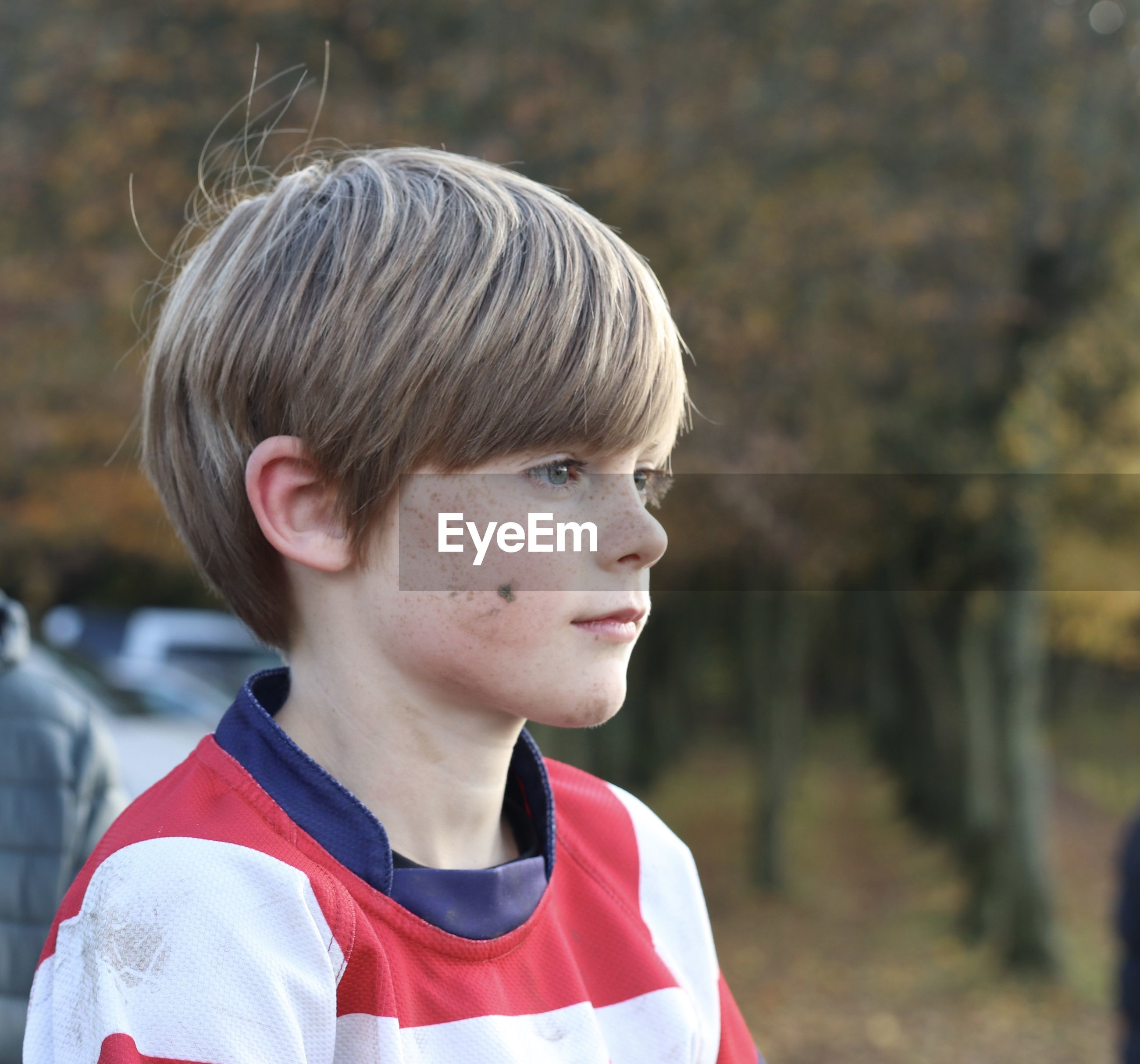 Close-up of boy looking away outdoors