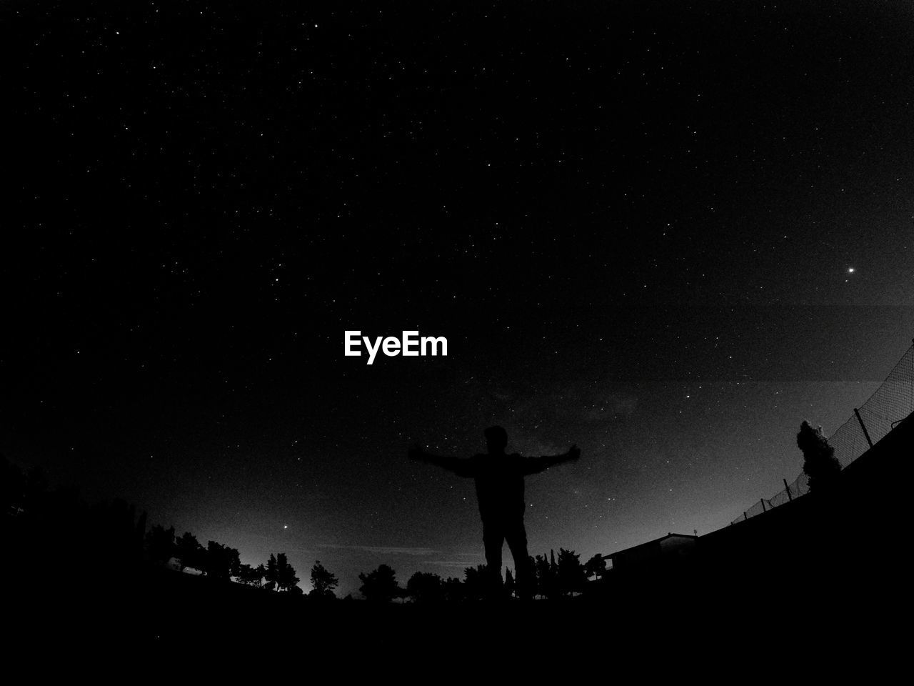silhouette, sky, human arm, star - space, night, real people, lifestyles, one person, space, leisure activity, men, arms outstretched, star, nature, standing, limb, field, star field, astronomy, arms raised, outdoors