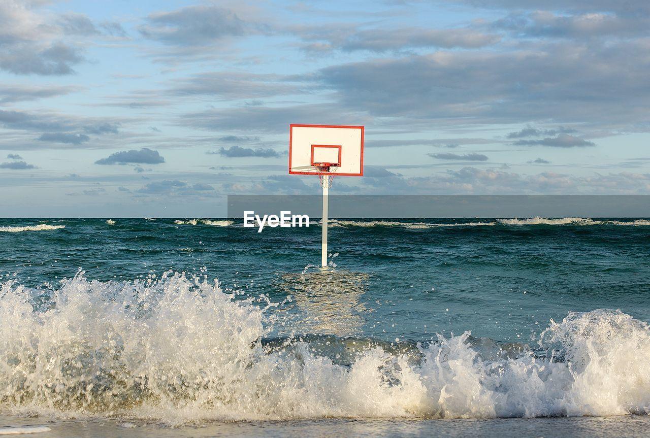 Basketball Hoop In Sea Against Sky
