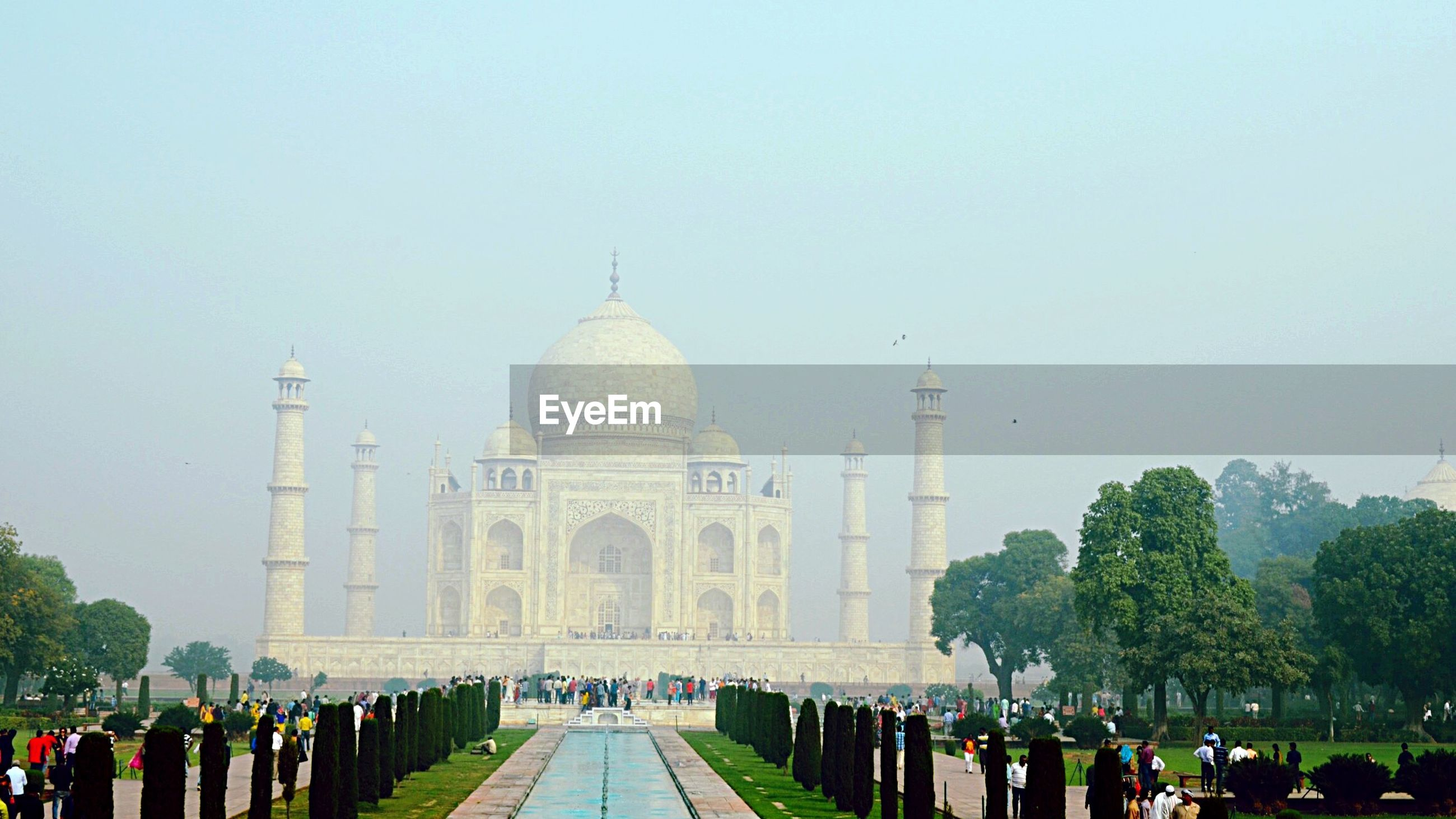 architecture, built structure, place of worship, religion, building exterior, dome, spirituality, famous place, clear sky, travel destinations, tourism, islam, international landmark, travel, mosque, tree, church, history