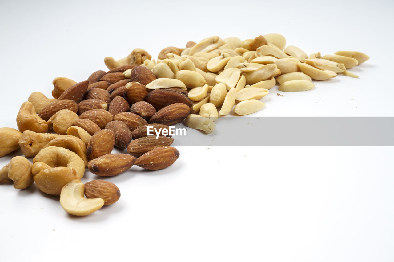 food and drink, food, white background, studio shot, freshness, indoors, large group of objects, close-up, wellbeing, no people, nut, still life, copy space, healthy eating, raw food, nut - food, seed, brown, high angle view, table, snack, temptation, vegetarian food