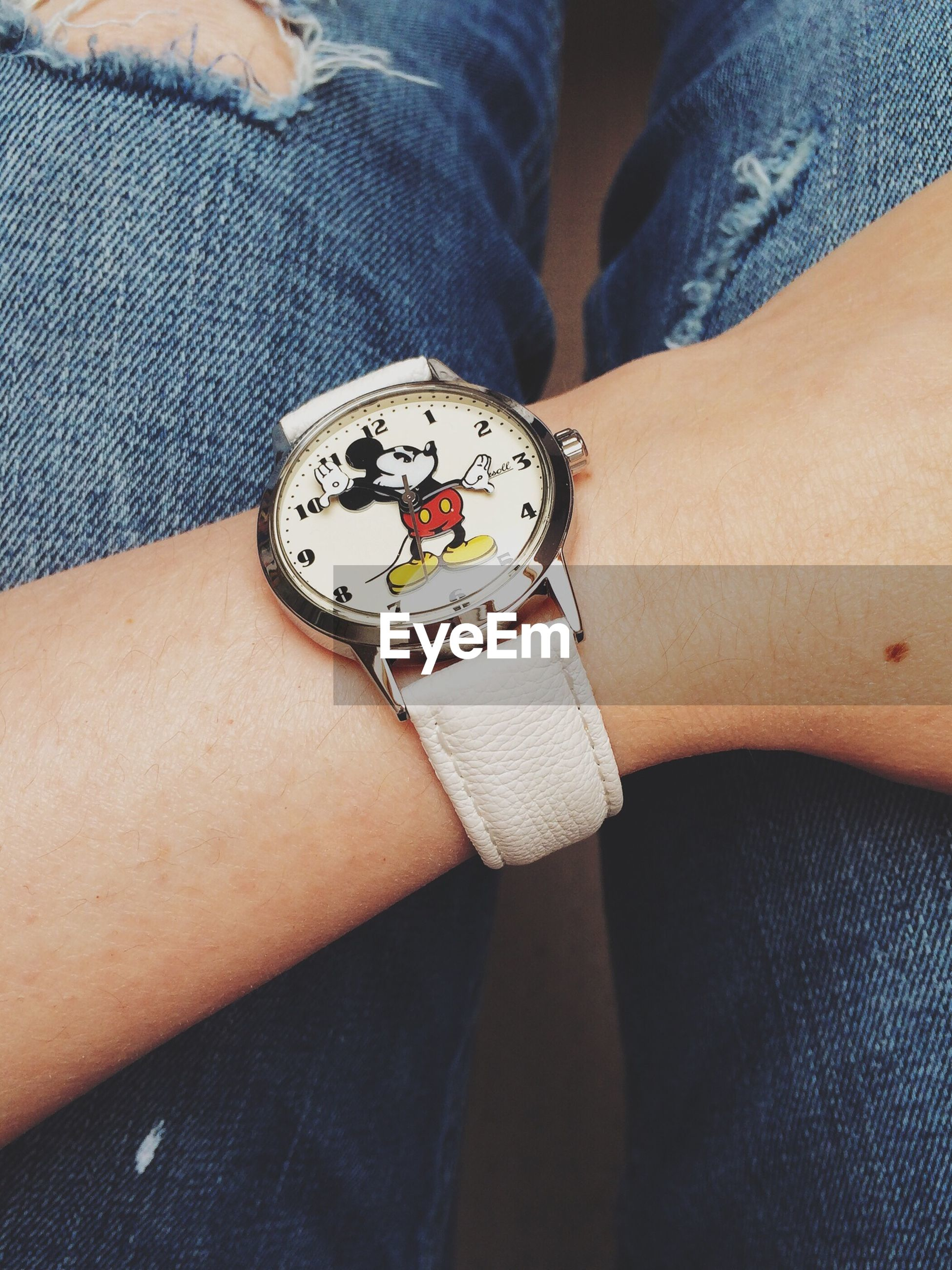 person, indoors, part of, lifestyles, holding, men, leisure activity, close-up, midsection, human finger, unrecognizable person, personal perspective, cropped, wristwatch, high angle view
