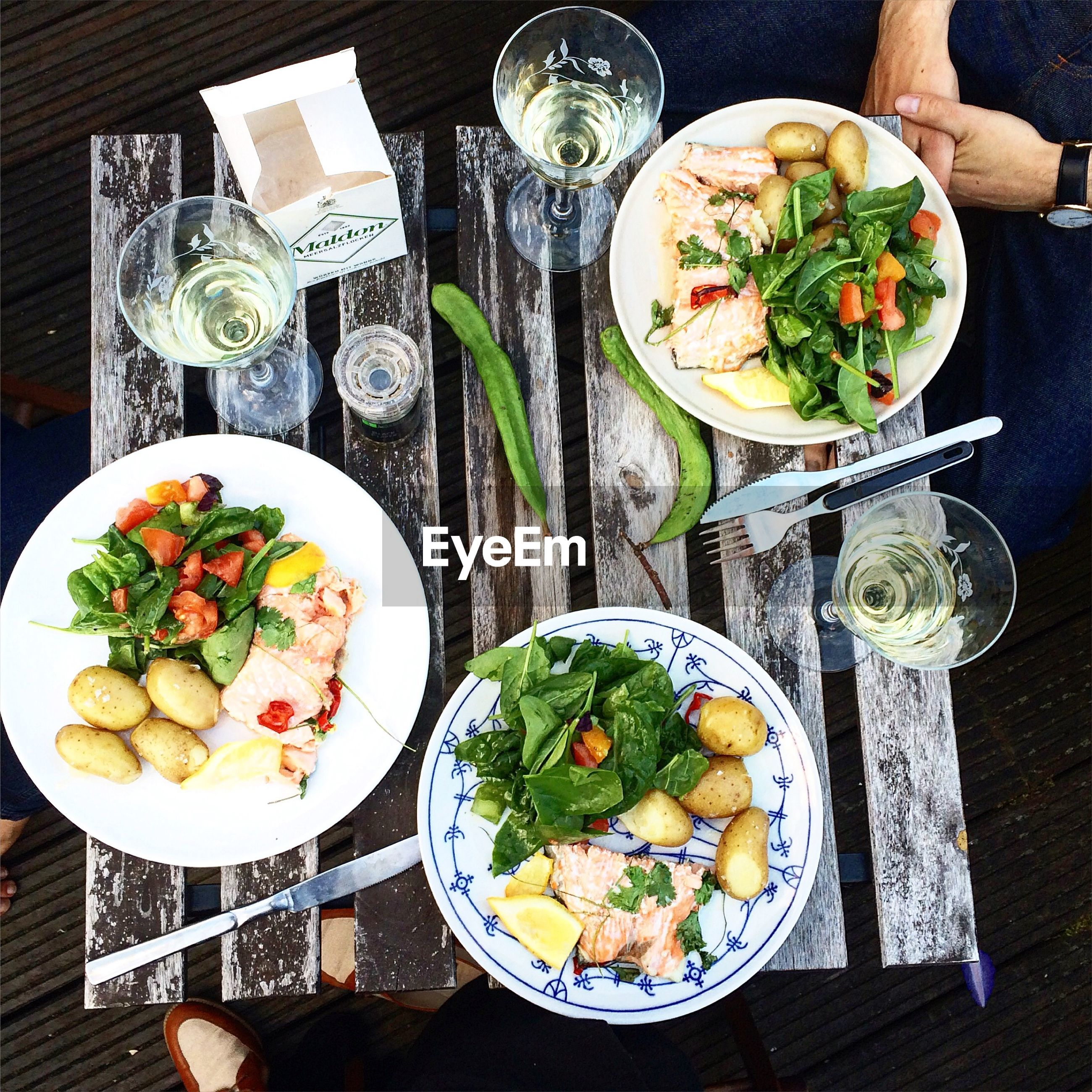 food and drink, table, indoors, food, freshness, plate, ready-to-eat, still life, healthy eating, serving size, meal, drinking glass, drink, high angle view, bowl, salad, fork, vegetable, served, restaurant
