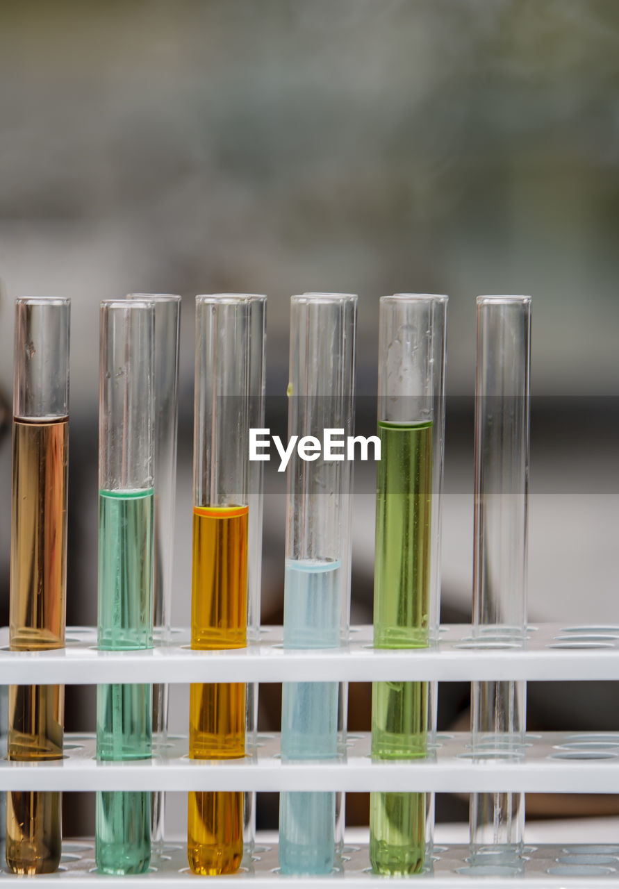 Close-up of test tubes on table