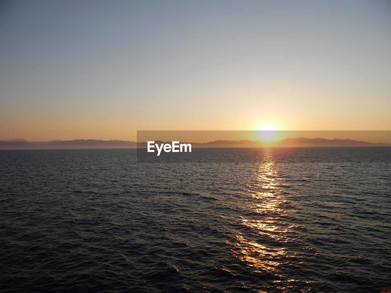 sky, sunset, water, sea, beauty in nature, scenics - nature, tranquility, waterfront, tranquil scene, sun, idyllic, nature, sunlight, orange color, horizon, non-urban scene, no people, remote, outdoors, horizon over water