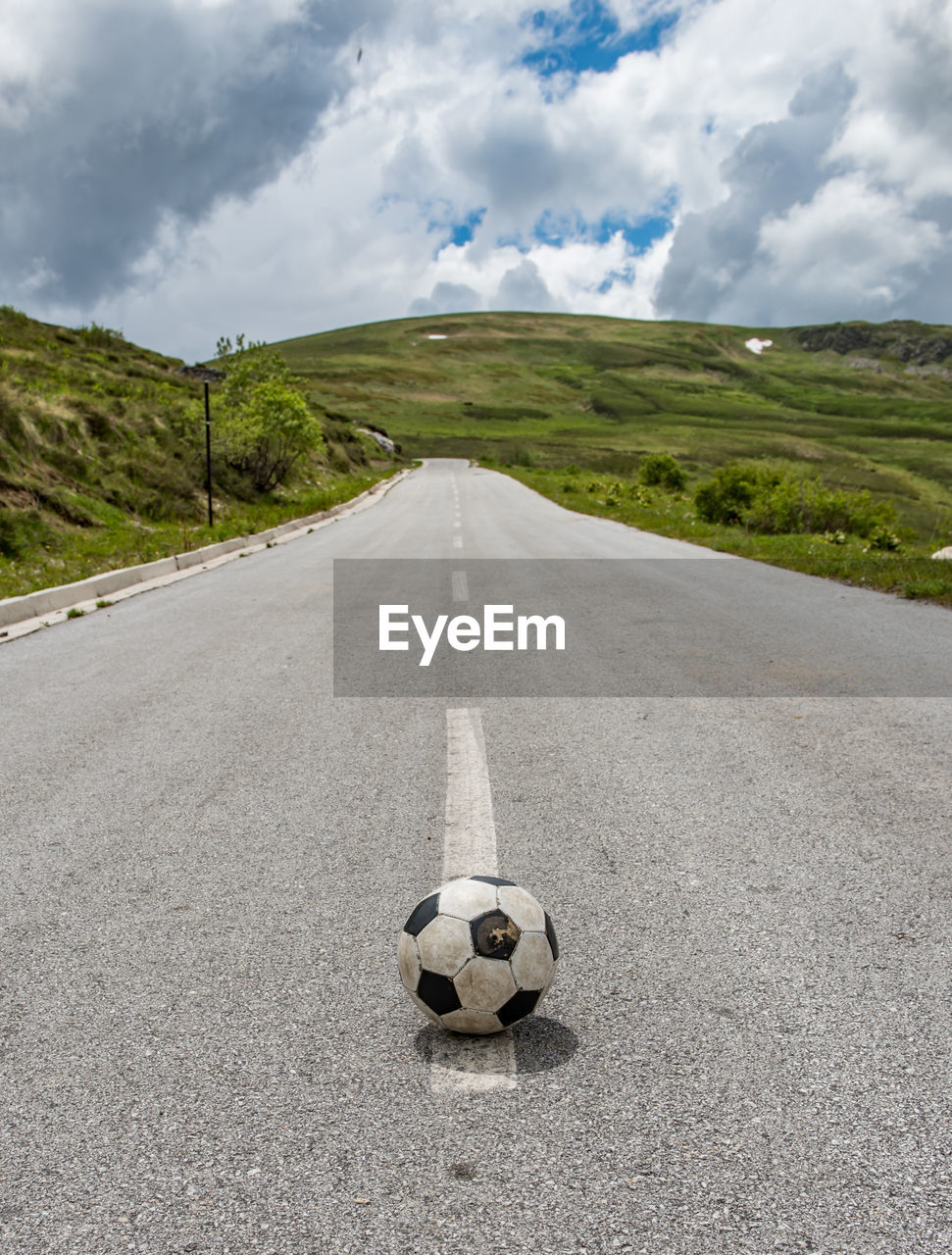 VIEW OF SOCCER BALL ON ROAD