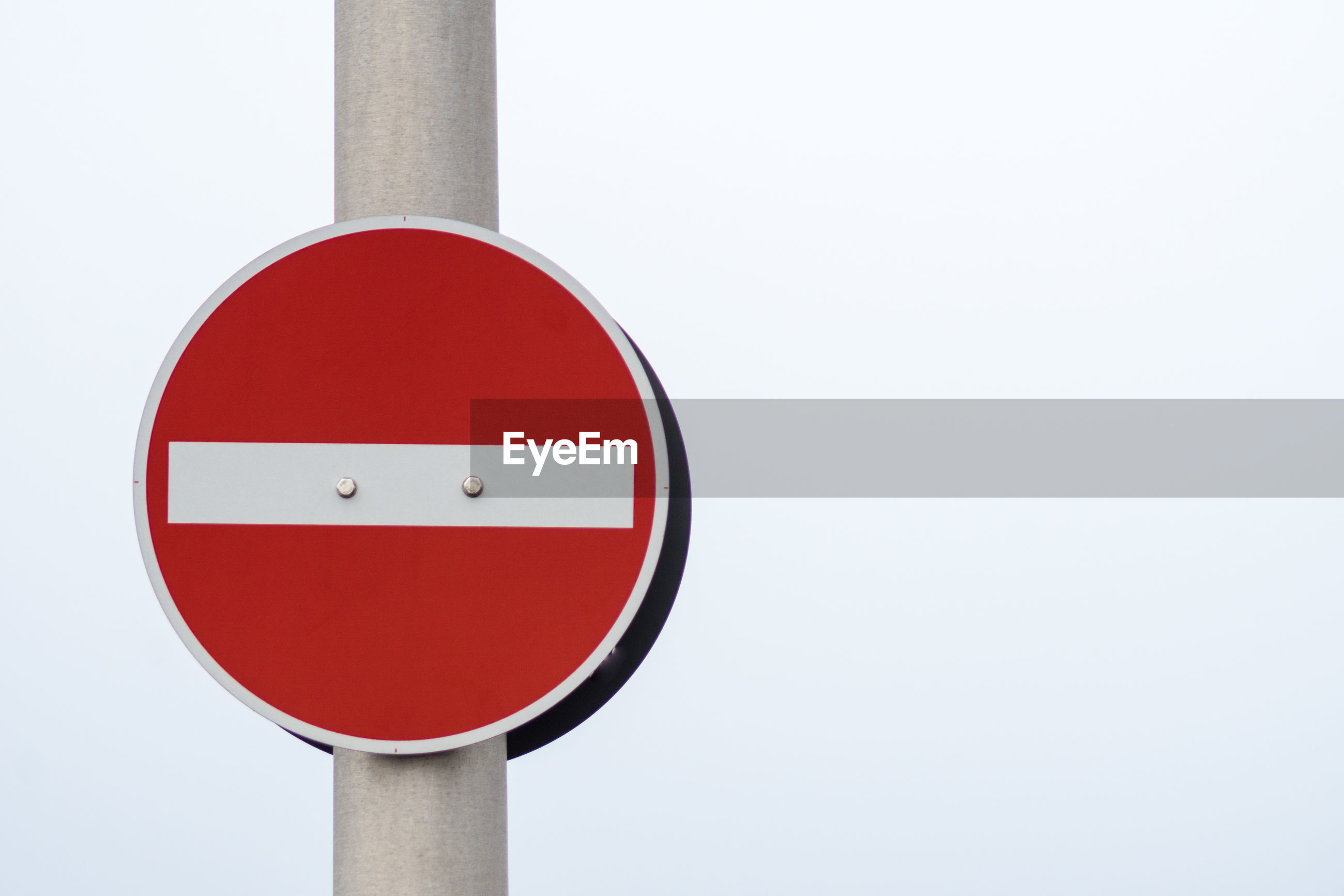 Close-up of do not enter sign against clear sky