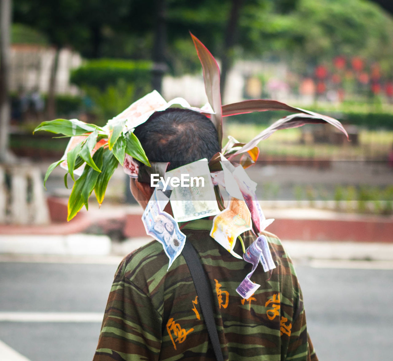 Man Wearing Wreath Of Paper Currency