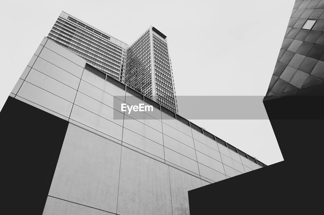 architecture, building exterior, low angle view, built structure, modern, no people, day, skyscraper, outdoors, city, sky