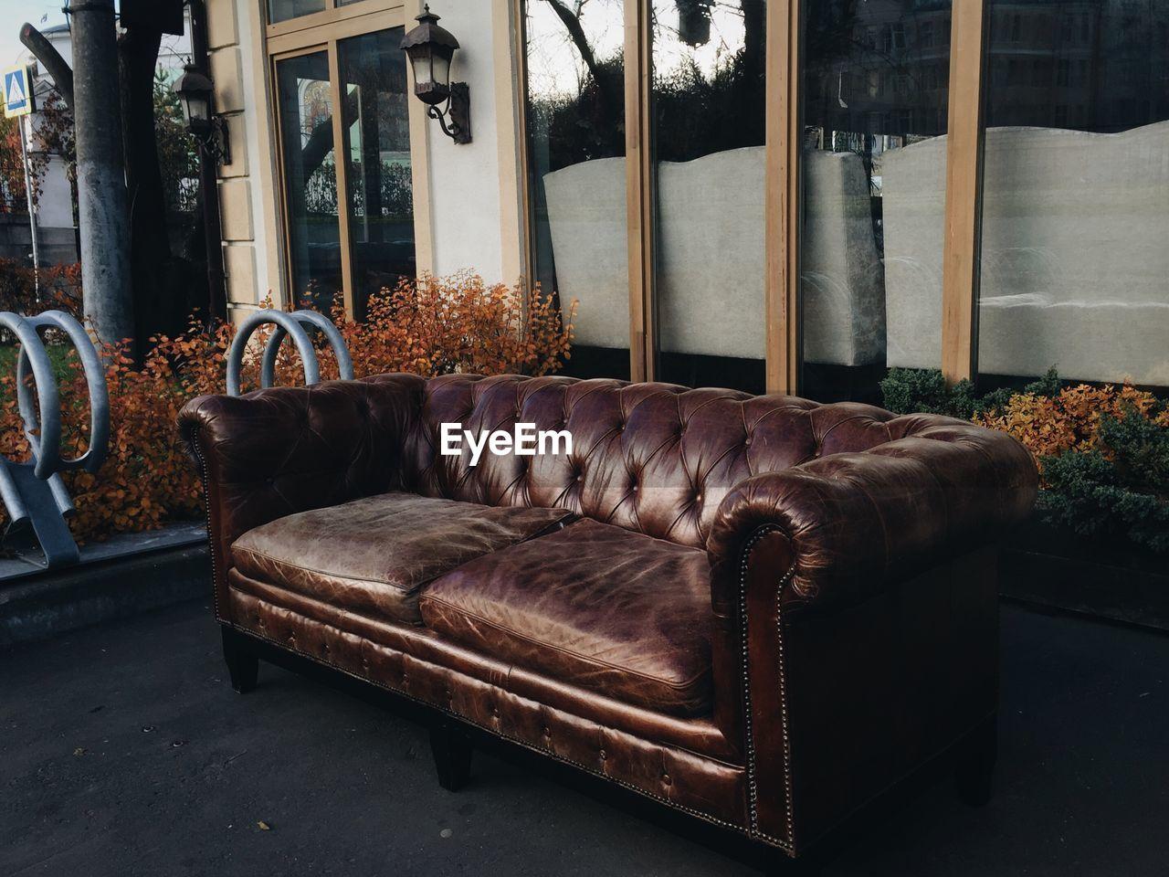 Brown sofa outside house