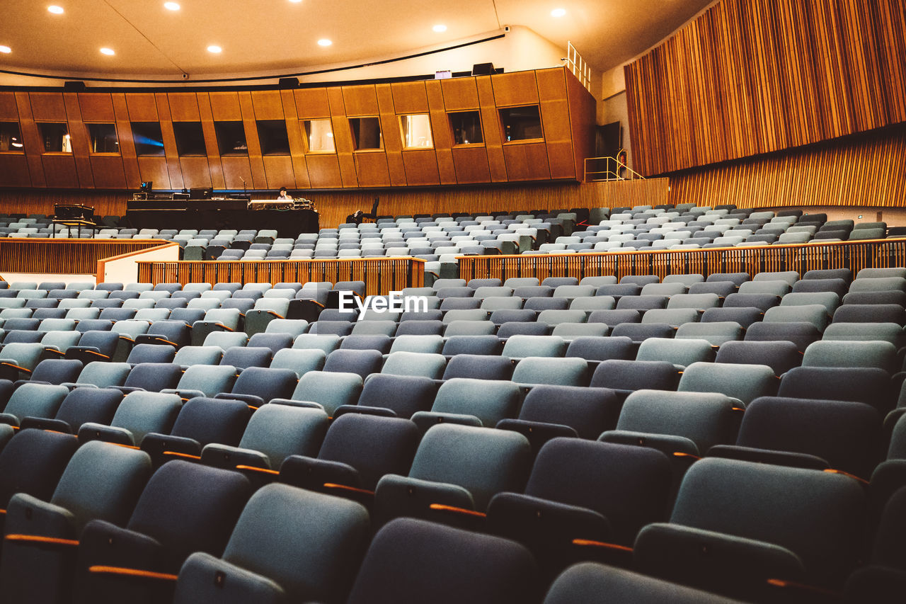 seat, in a row, indoors, auditorium, empty, chair, arts culture and entertainment, no people, architecture, day