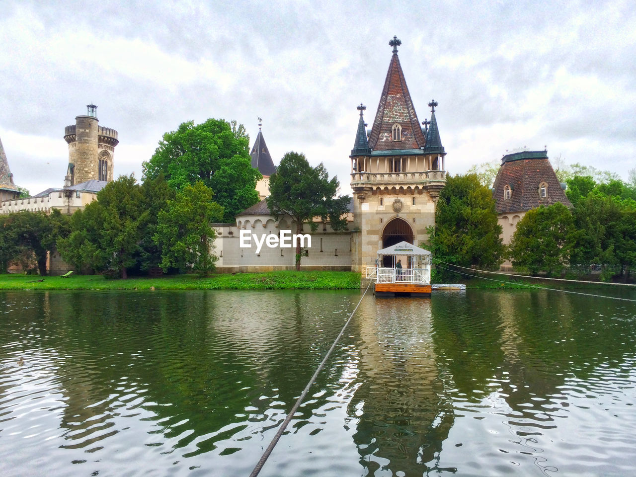 architecture, built structure, building exterior, water, history, waterfront, day, transportation, river, sky, no people, outdoors, travel destinations, tree, castle, place of worship, nautical vessel, nature, city