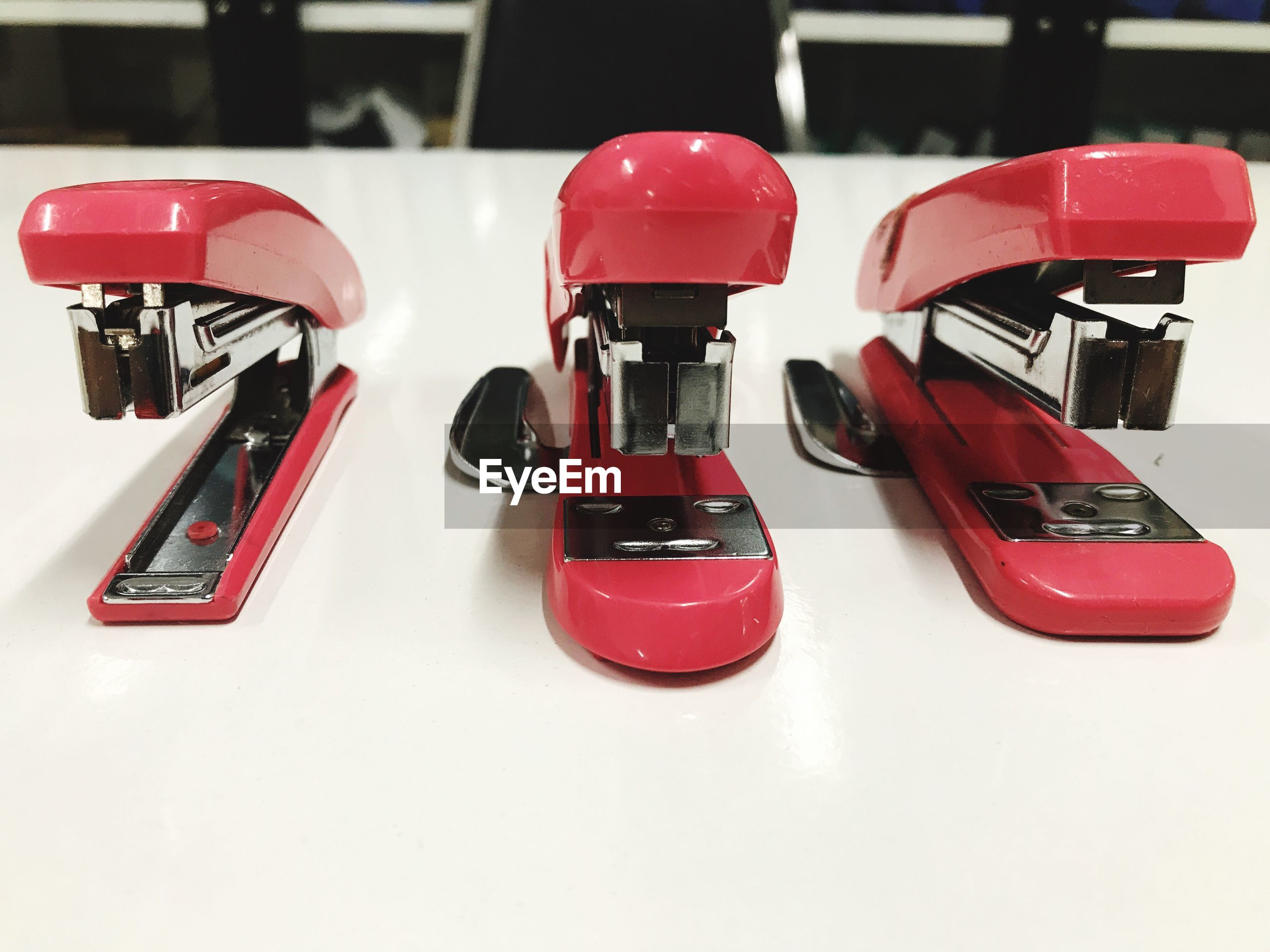Close-up of staplers on table