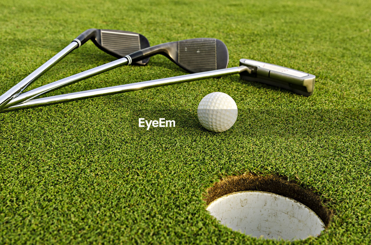 Golf Club And Ball On Field