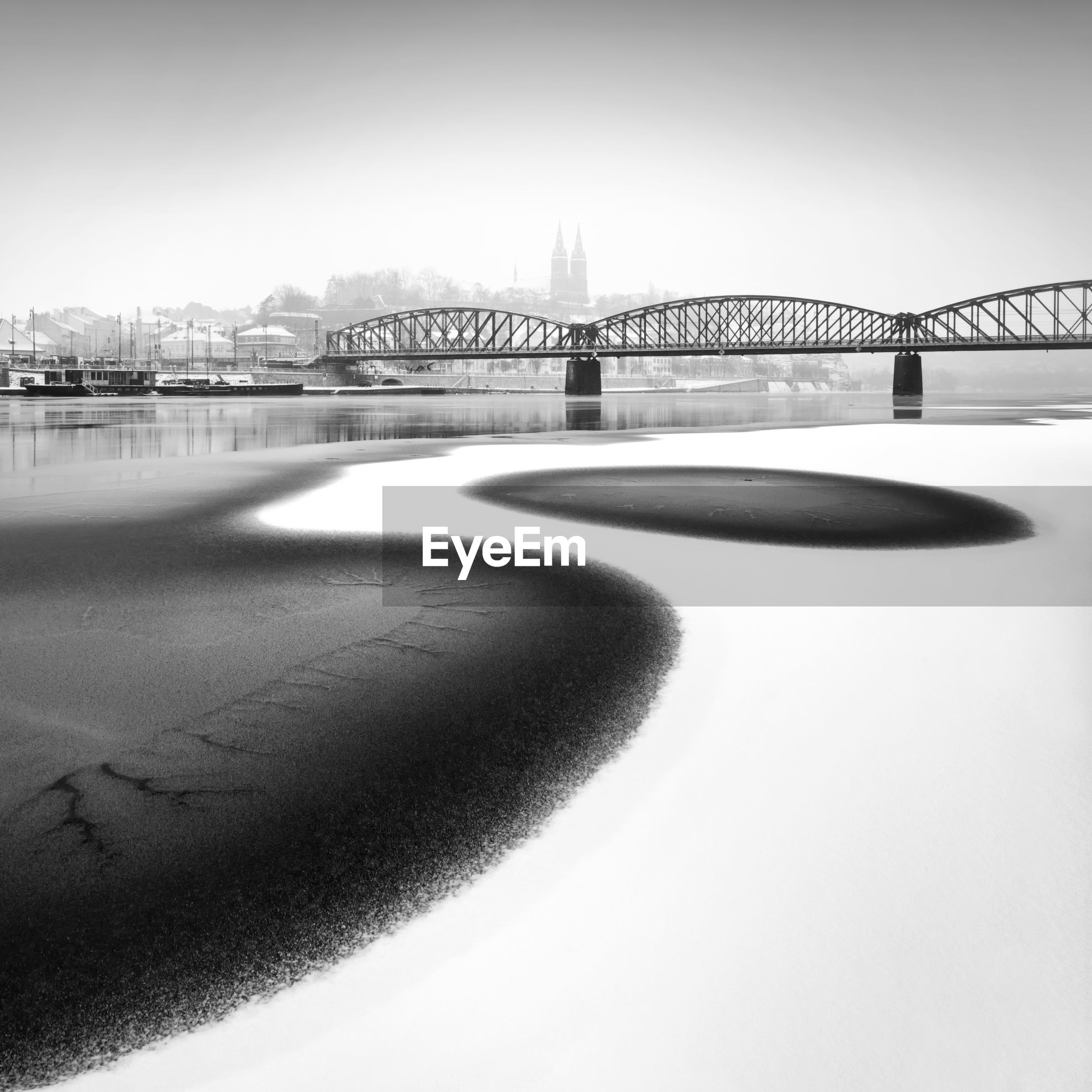 Frozen river in city