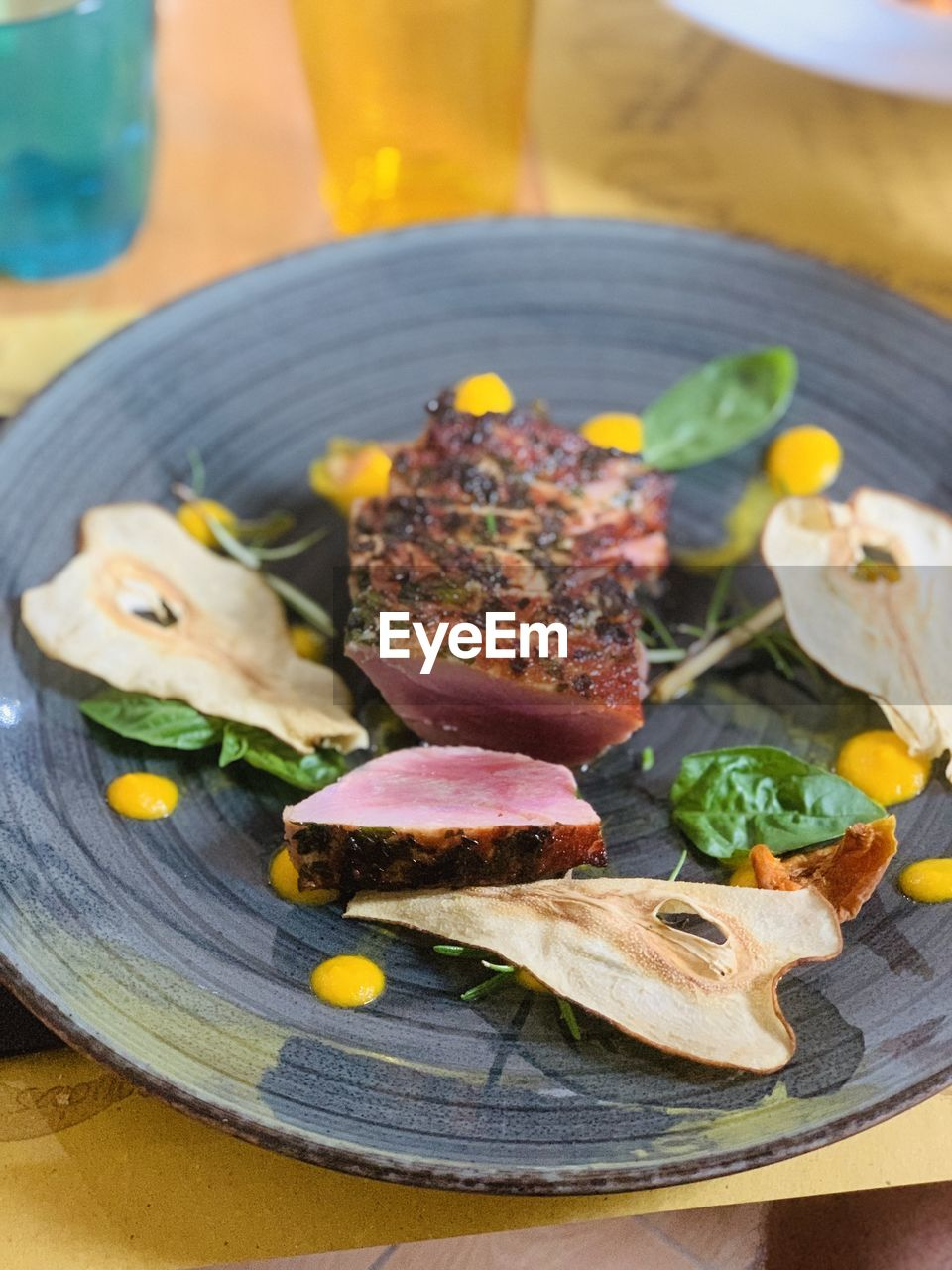 food, food and drink, plate, freshness, table, ready-to-eat, close-up, meat, no people, serving size, indoors, vegetable, still life, wood - material, meal, healthy eating, indulgence, focus on foreground, high angle view, selective focus, herb, garnish, temptation