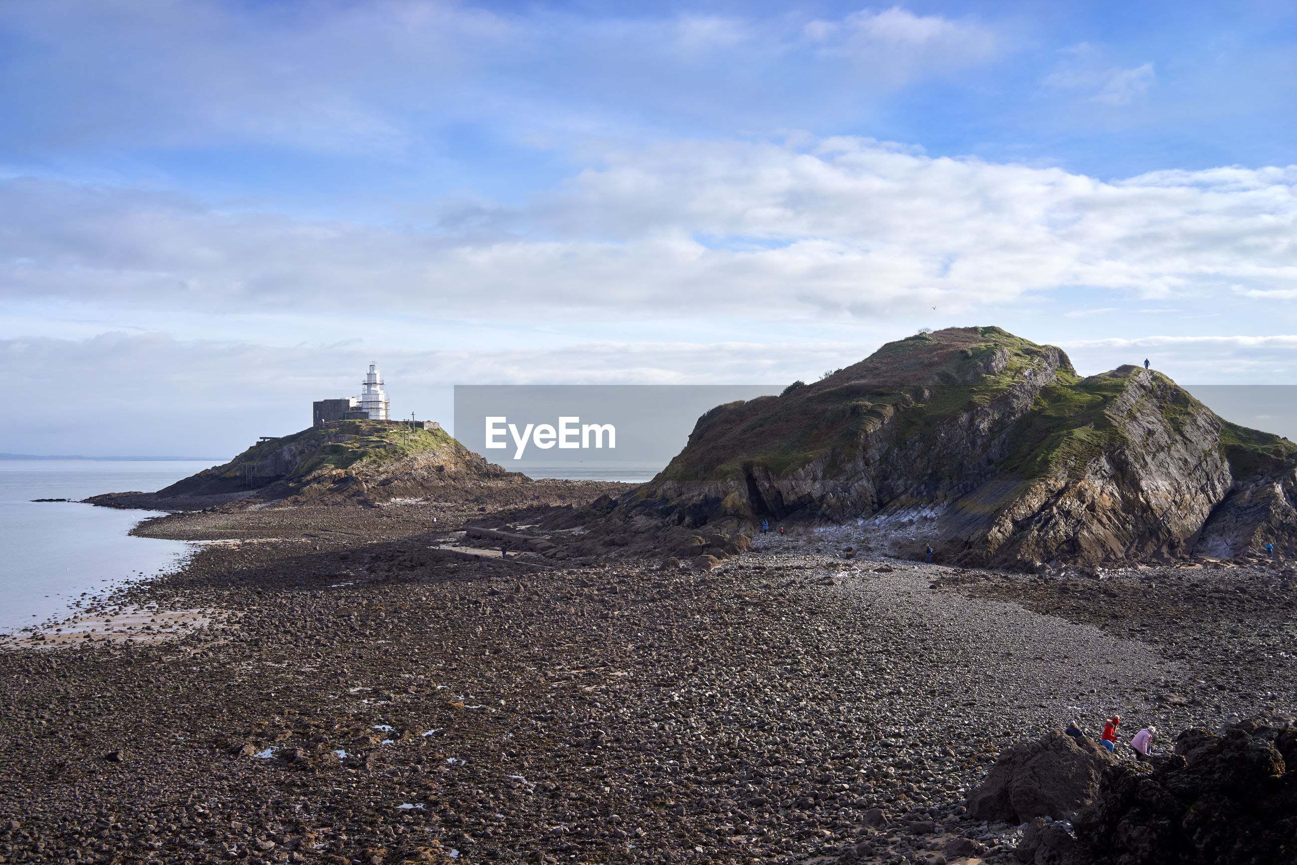 View of rock formation on beach against sky