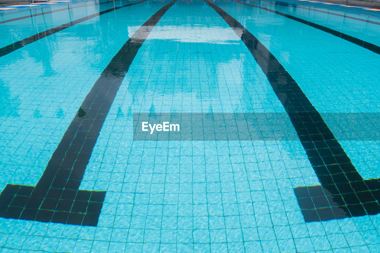 pool, swimming pool, water, flooring, blue, tile, high angle view, poolside, nature, day, reflection, no people, turquoise colored, transparent, tiled floor, swimming, pattern, swimming lane marker, shape