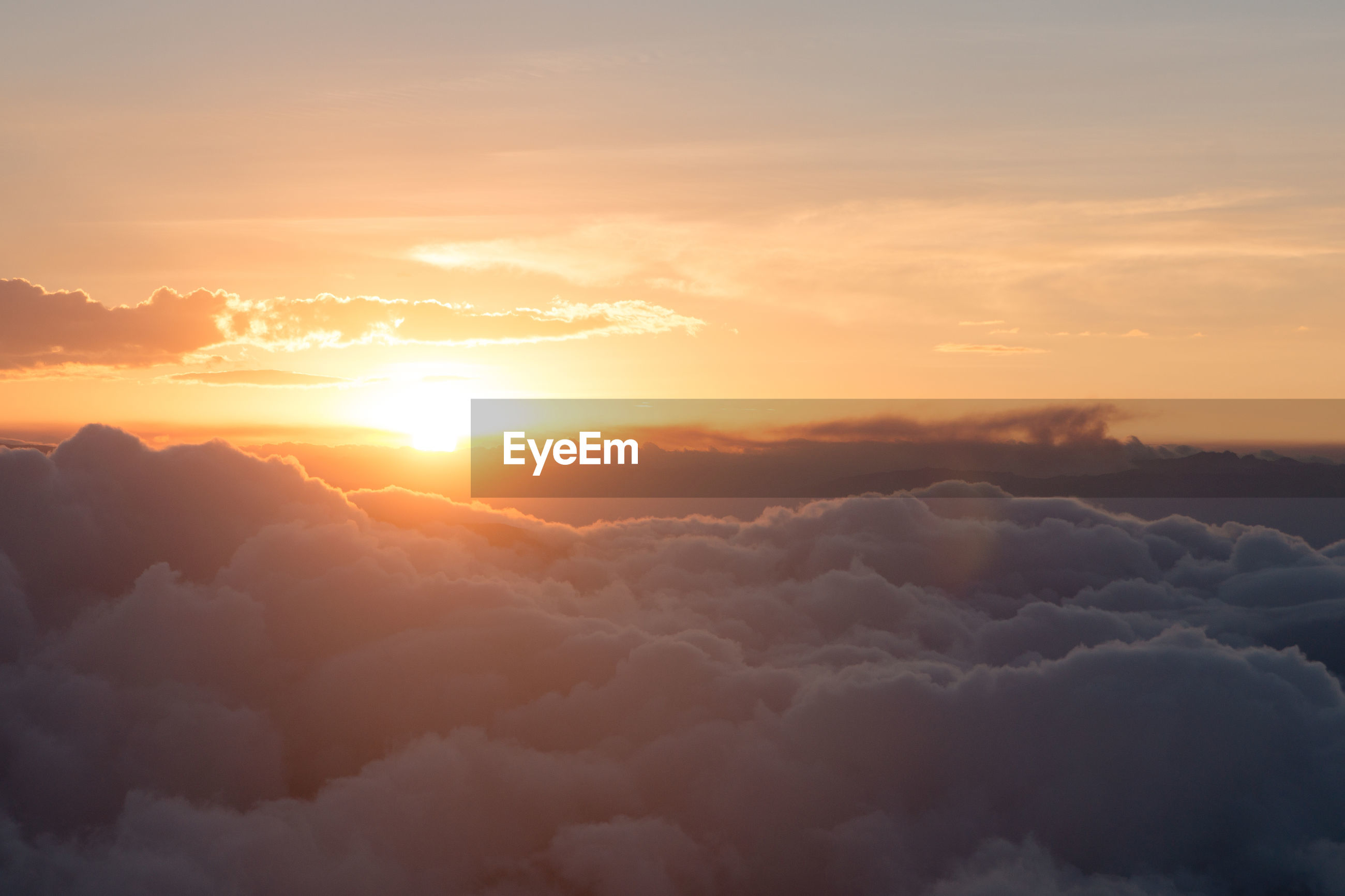 SCENIC VIEW OF CLOUDS DURING SUNSET