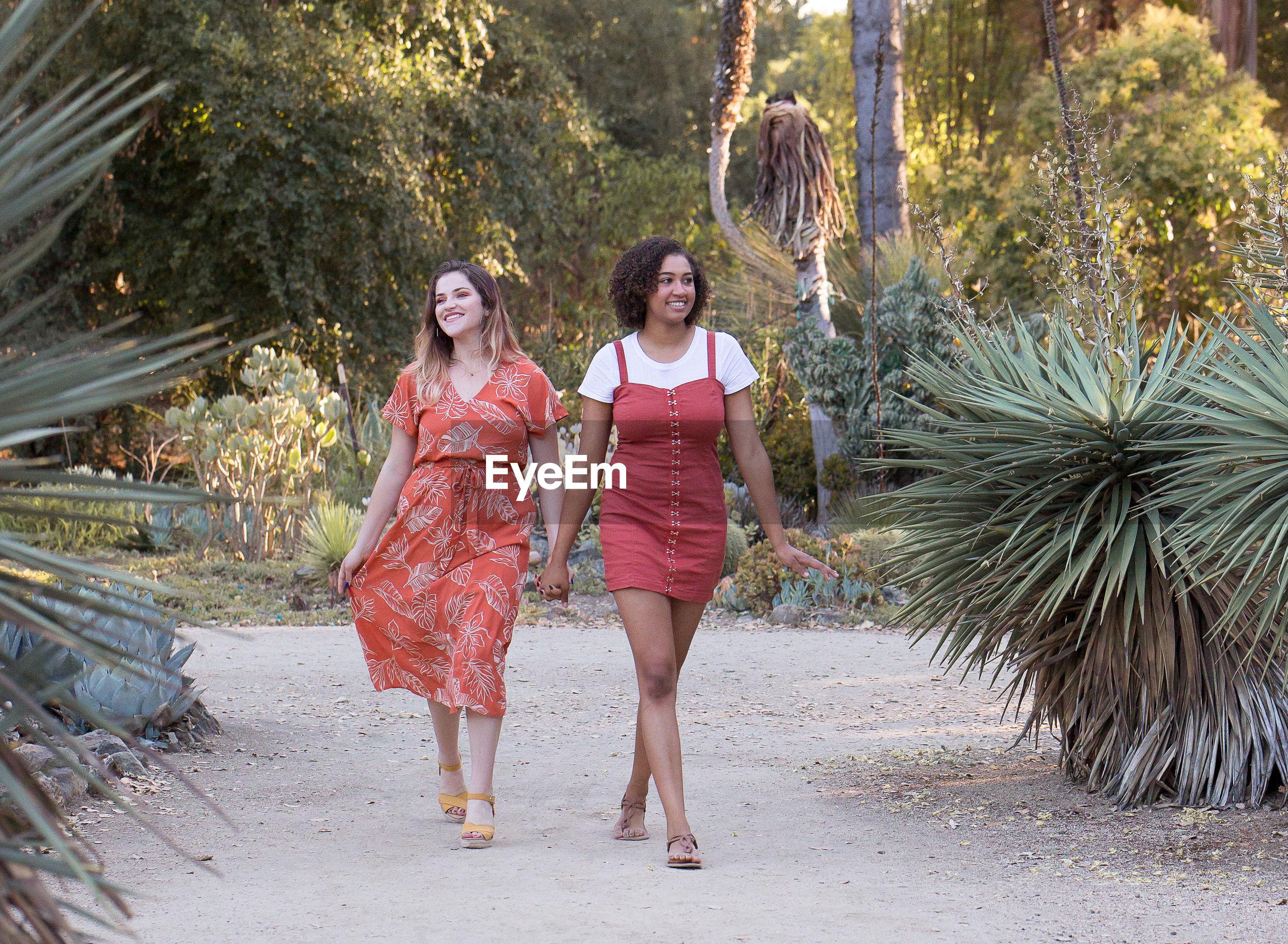 Smiling couple walking on land