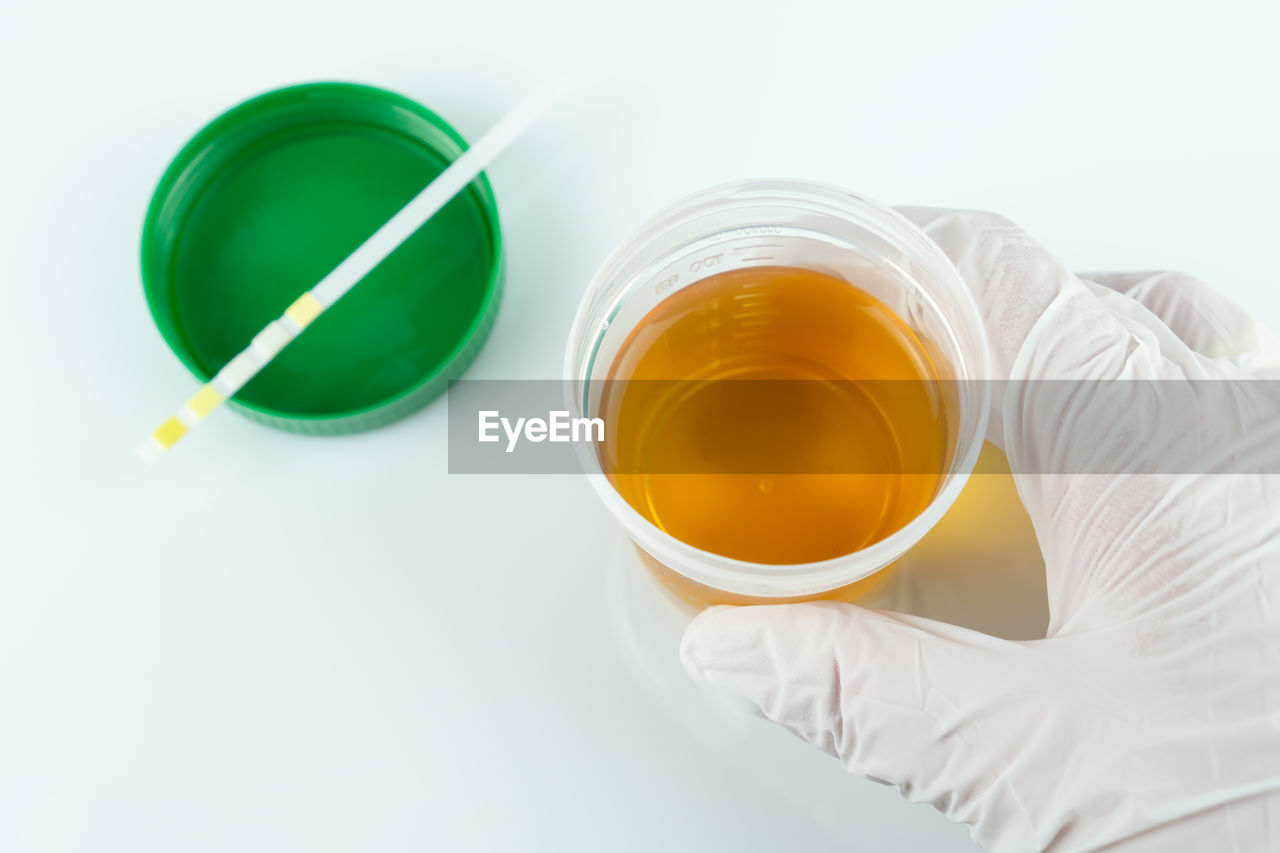 indoors, drink, cup, refreshment, food and drink, tea, high angle view, studio shot, white background, tea - hot drink, still life, close-up, hot drink, mug, freshness, food, one person, white color, green color, tea cup, glass, crockery