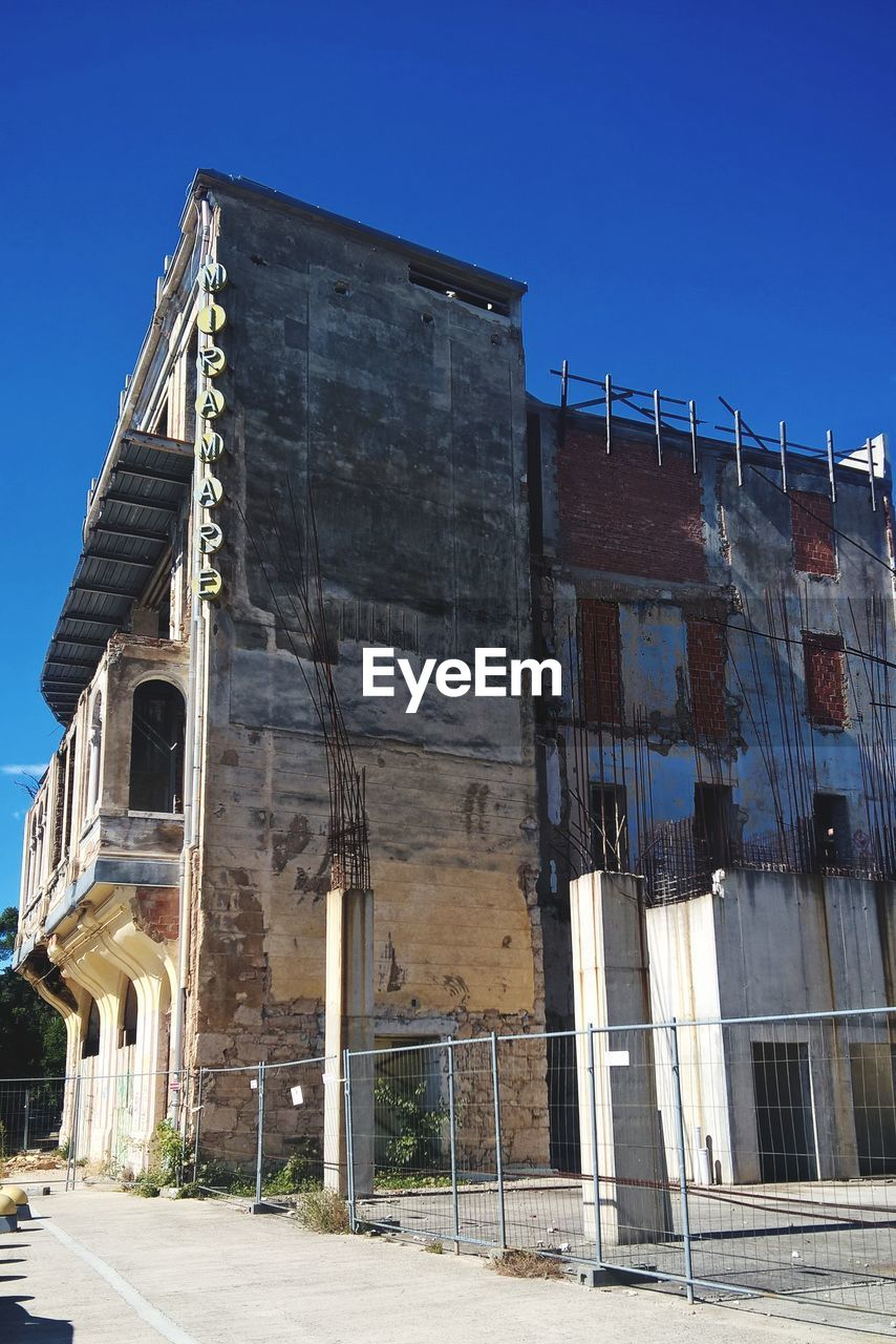 built structure, architecture, sky, building exterior, building, nature, day, clear sky, abandoned, no people, sunlight, outdoors, low angle view, old, blue, history, run-down, city, industry, obsolete, ruined