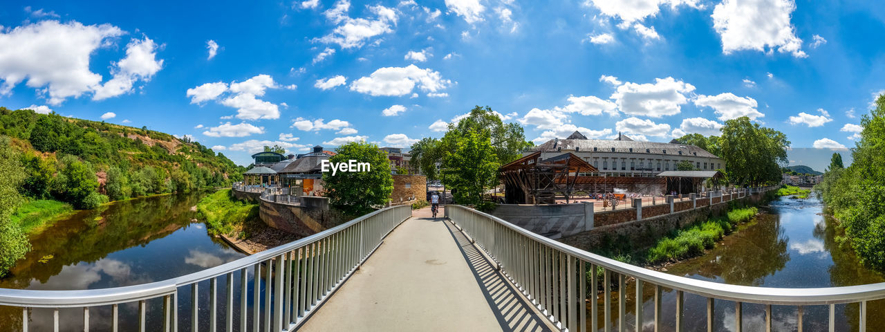 PANORAMIC SHOT OF FOOTBRIDGE OVER CANAL AGAINST SKY