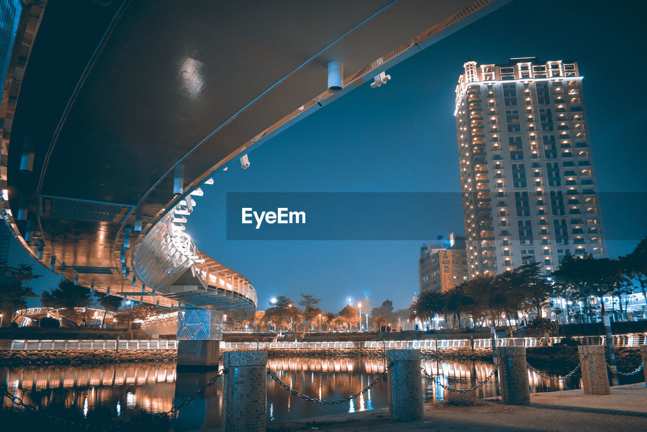 built structure, architecture, water, illuminated, building exterior, reflection, connection, night, nature, bridge, bridge - man made structure, waterfront, river, sky, building, no people, city, travel destinations, outdoors, office building exterior, modern, skyscraper