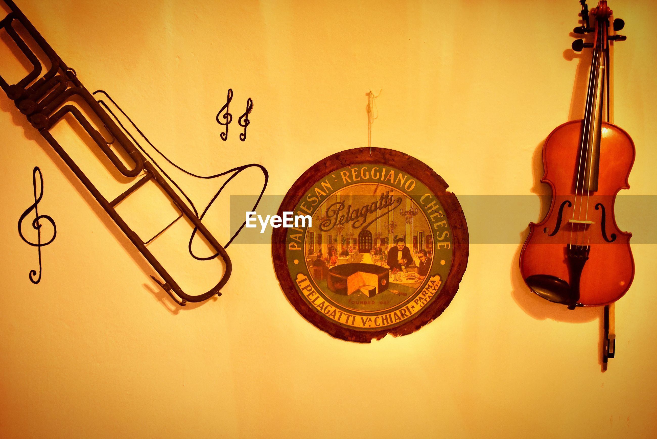 music, musical instrument, musical equipment, string instrument, arts culture and entertainment, indoors, wall - building feature, violin, hanging, no people, string, musical instrument string, still life, close-up, wood - material, guitar, text, art and craft, studio shot, number