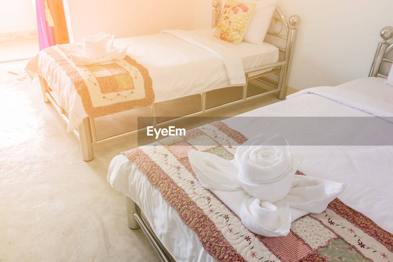 bed, furniture, indoors, bedroom, pillow, high angle view, no people, domestic room, absence, table, white color, still life, home interior, comfortable, cup, mug, linen, food and drink, textile, relaxation, cozy, luxury, tray