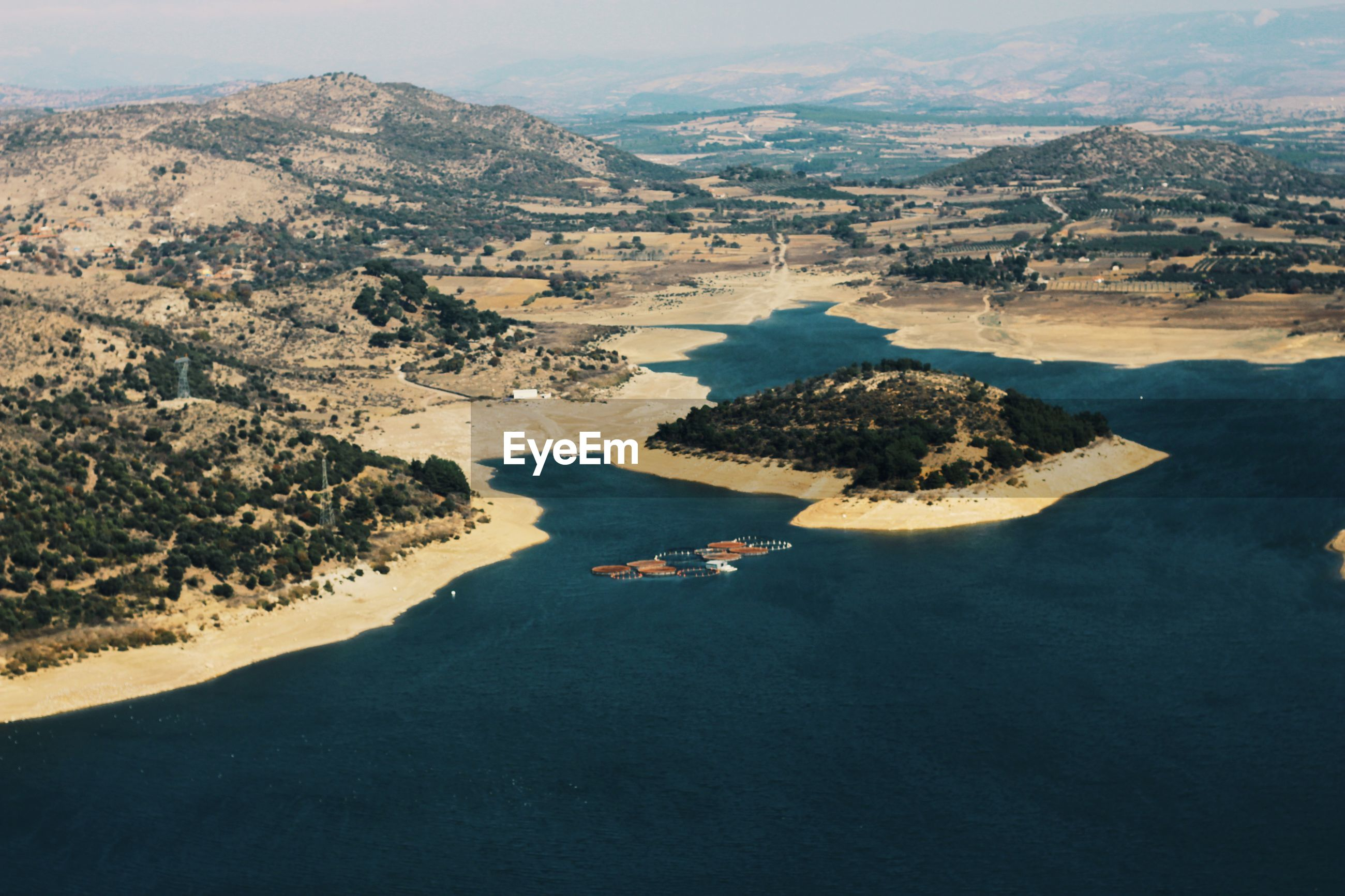 HIGH ANGLE VIEW OF SEA AND MOUNTAIN