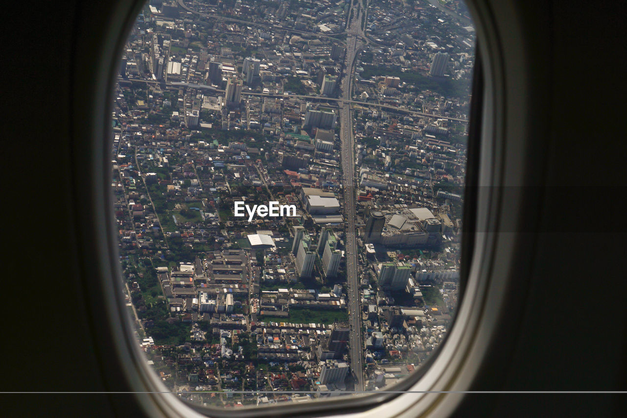 View of city seen through airplane window