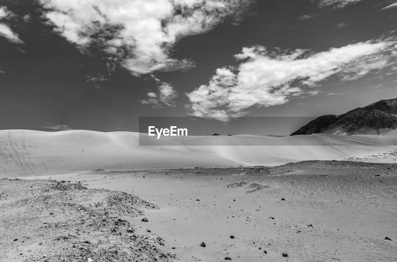 cloud - sky, sky, scenics - nature, beauty in nature, tranquil scene, tranquility, land, mountain, landscape, nature, environment, day, non-urban scene, no people, desert, remote, outdoors, idyllic, sand, arid climate, climate
