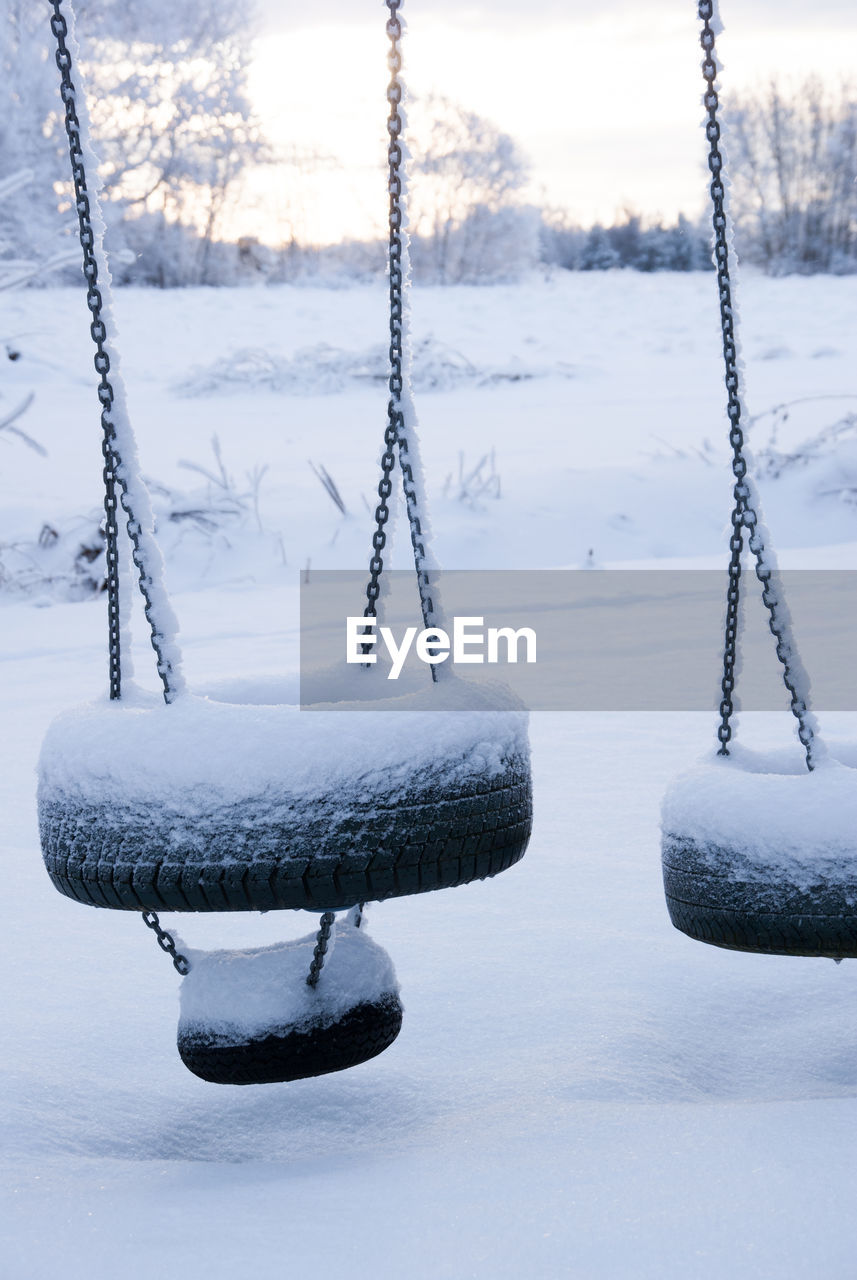 winter, snow, cold temperature, frozen, nature, no people, day, beauty in nature, land, focus on foreground, ice, white color, tranquil scene, tranquility, rope, scenics - nature, swing, chain, field, outdoors, icicle